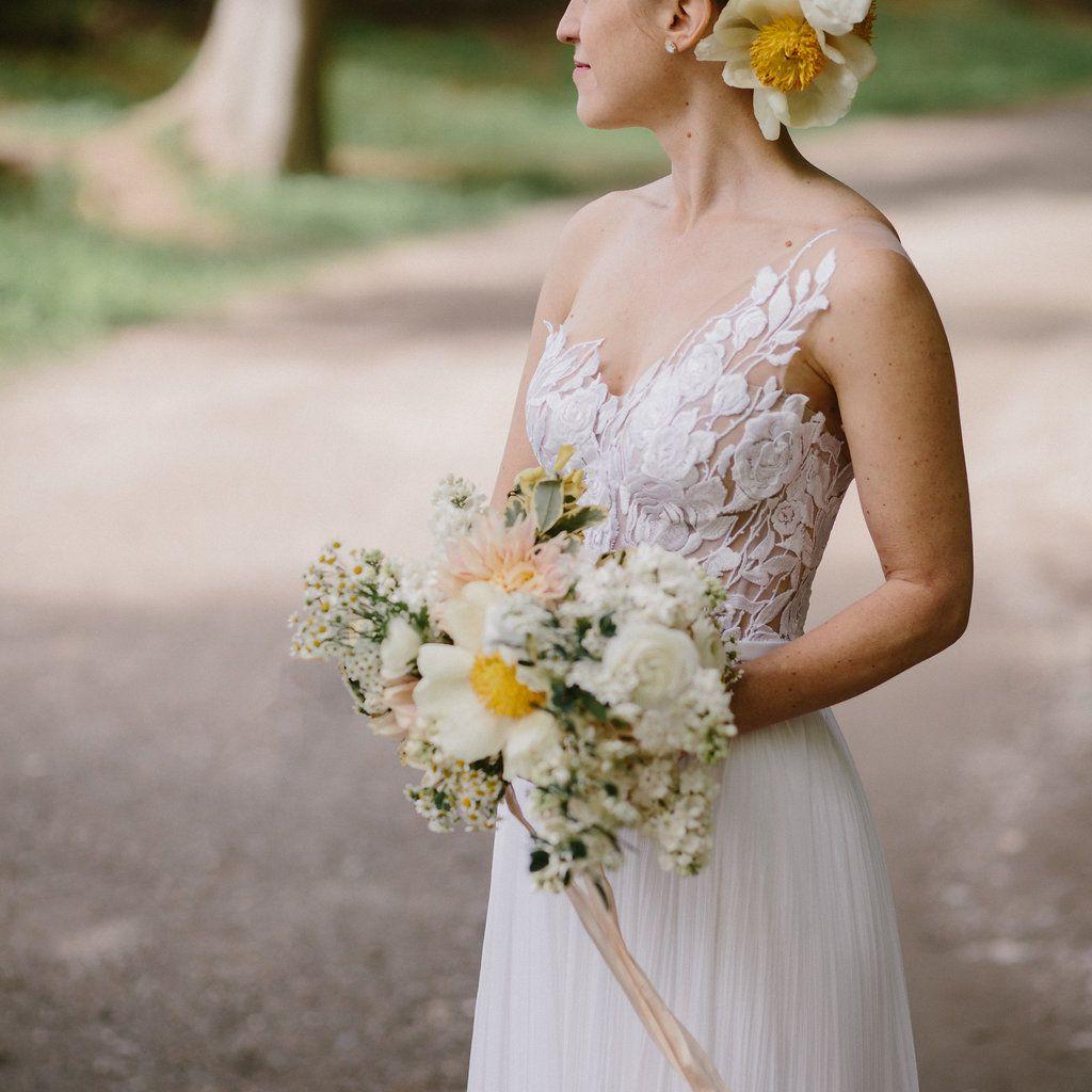 Bride holding bouquet solo shot