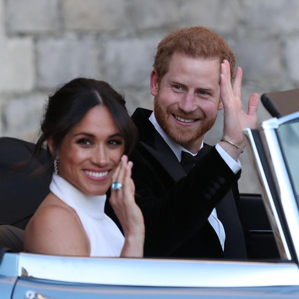 Prince Harry and Meghan Markle depart for their evening wedding reception.