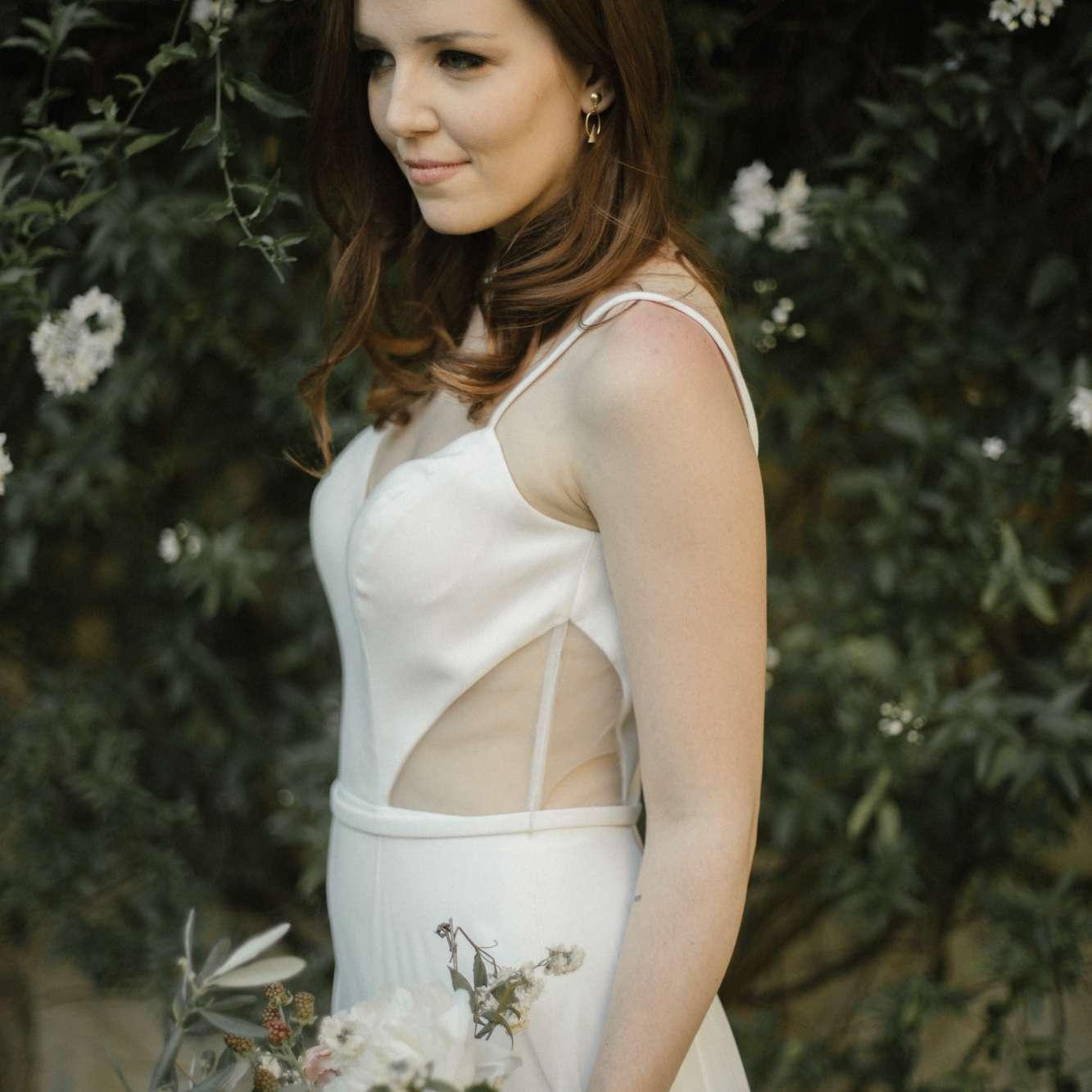 wedding dress with illusion cutouts