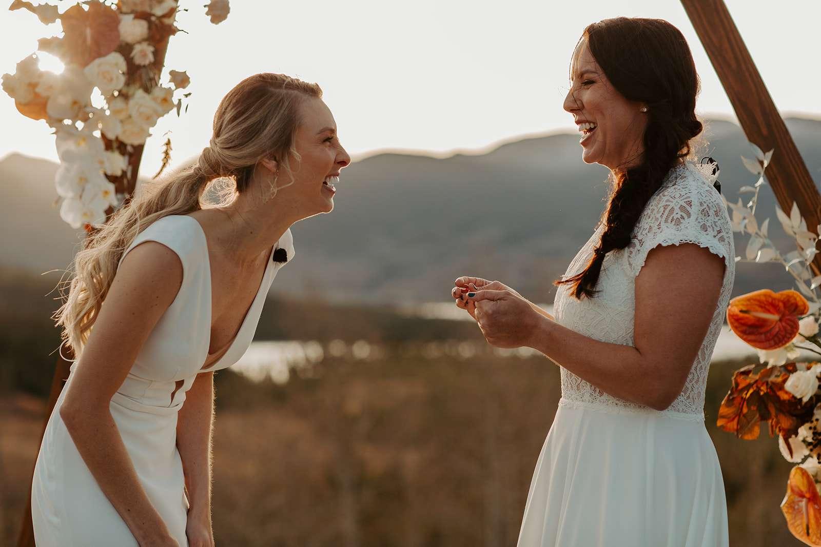 Brides laugh at altar