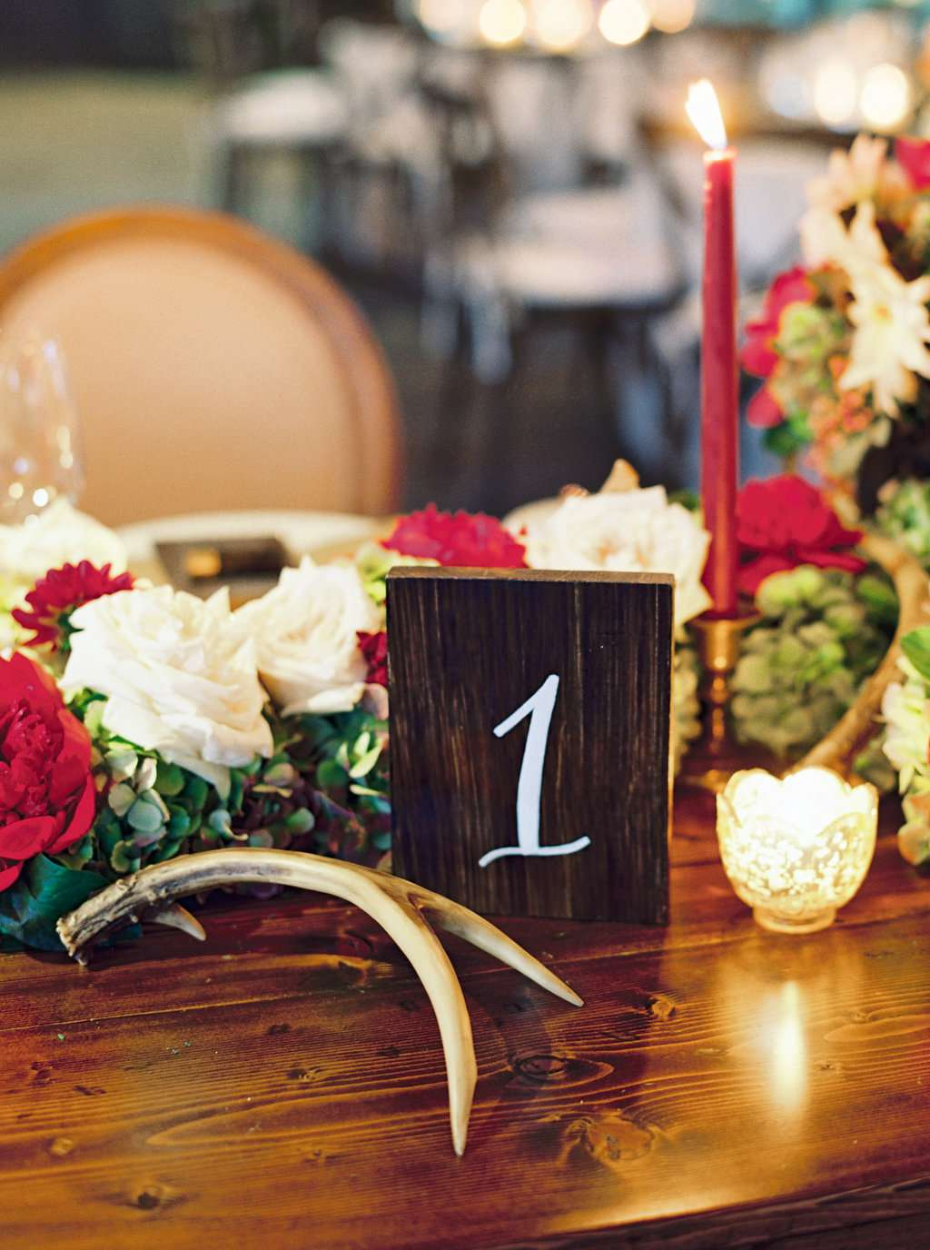 Wooden decor elements on a reception table