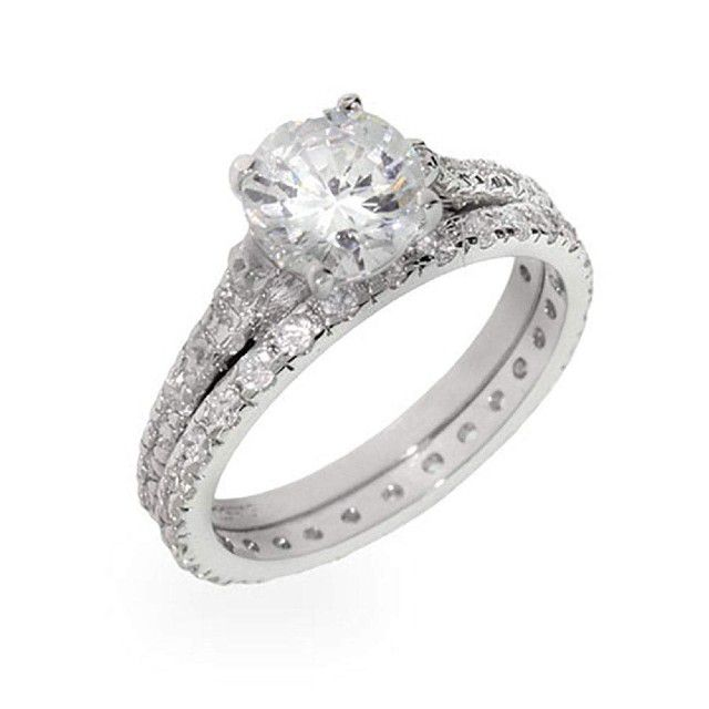 thin band round solitaire ring