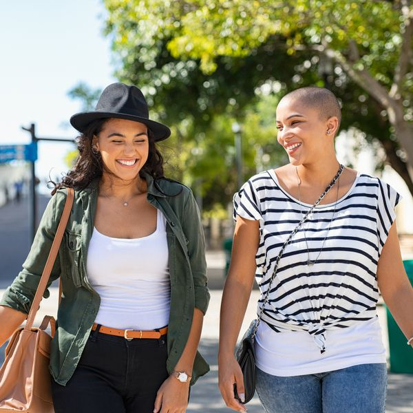 Two women walking down the street together