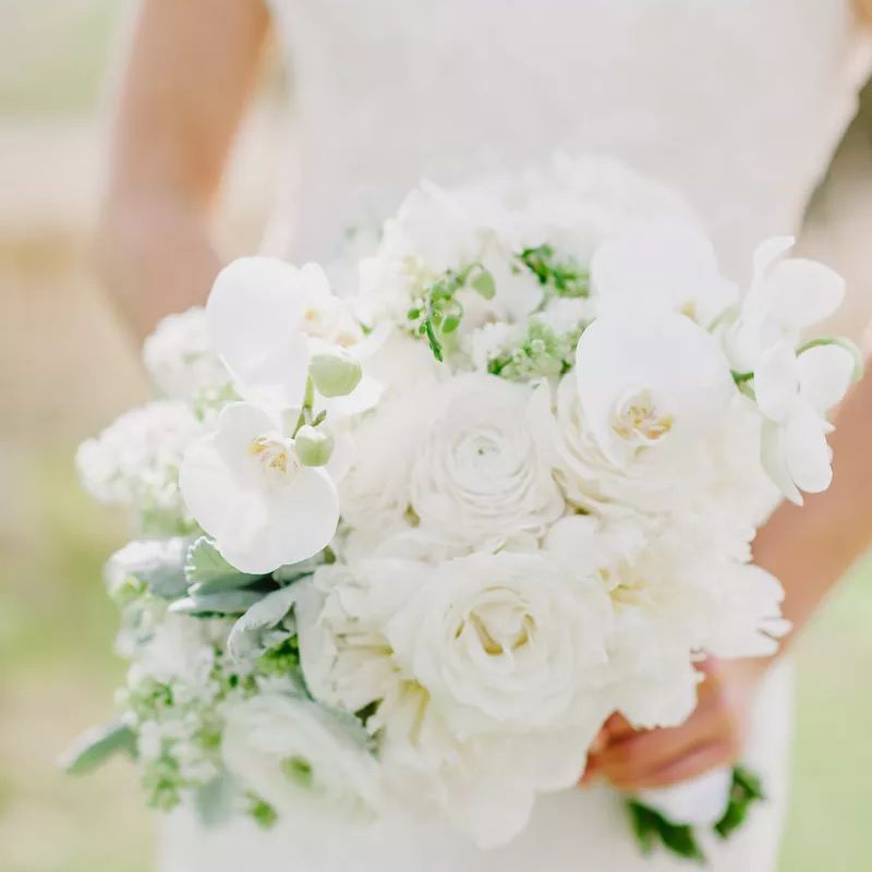 White wedding bouquet with sweet peas