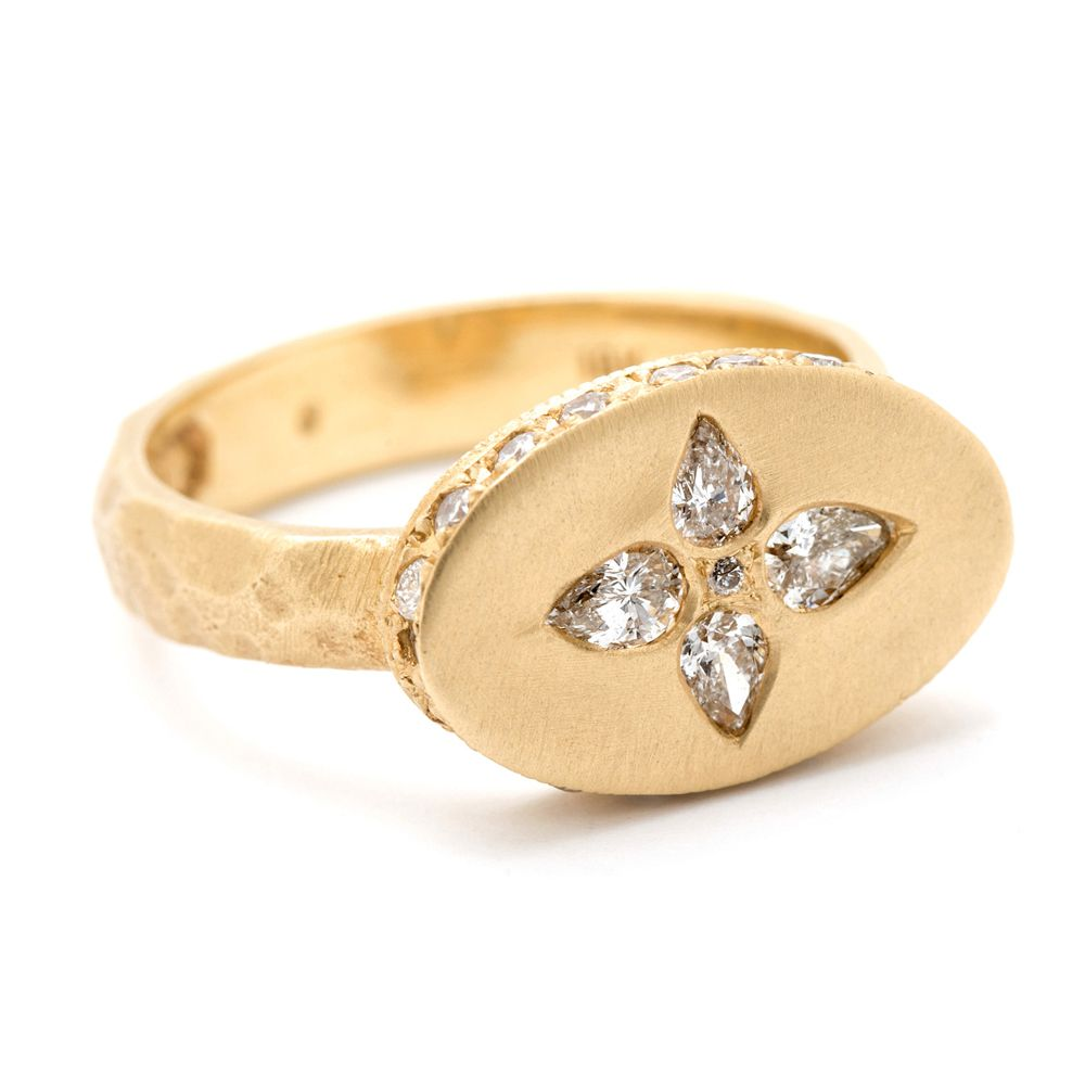 Diamond signet engagement ring with yellow gold band on a white background