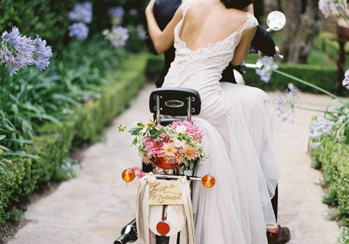 bride and groom on getaway scooter
