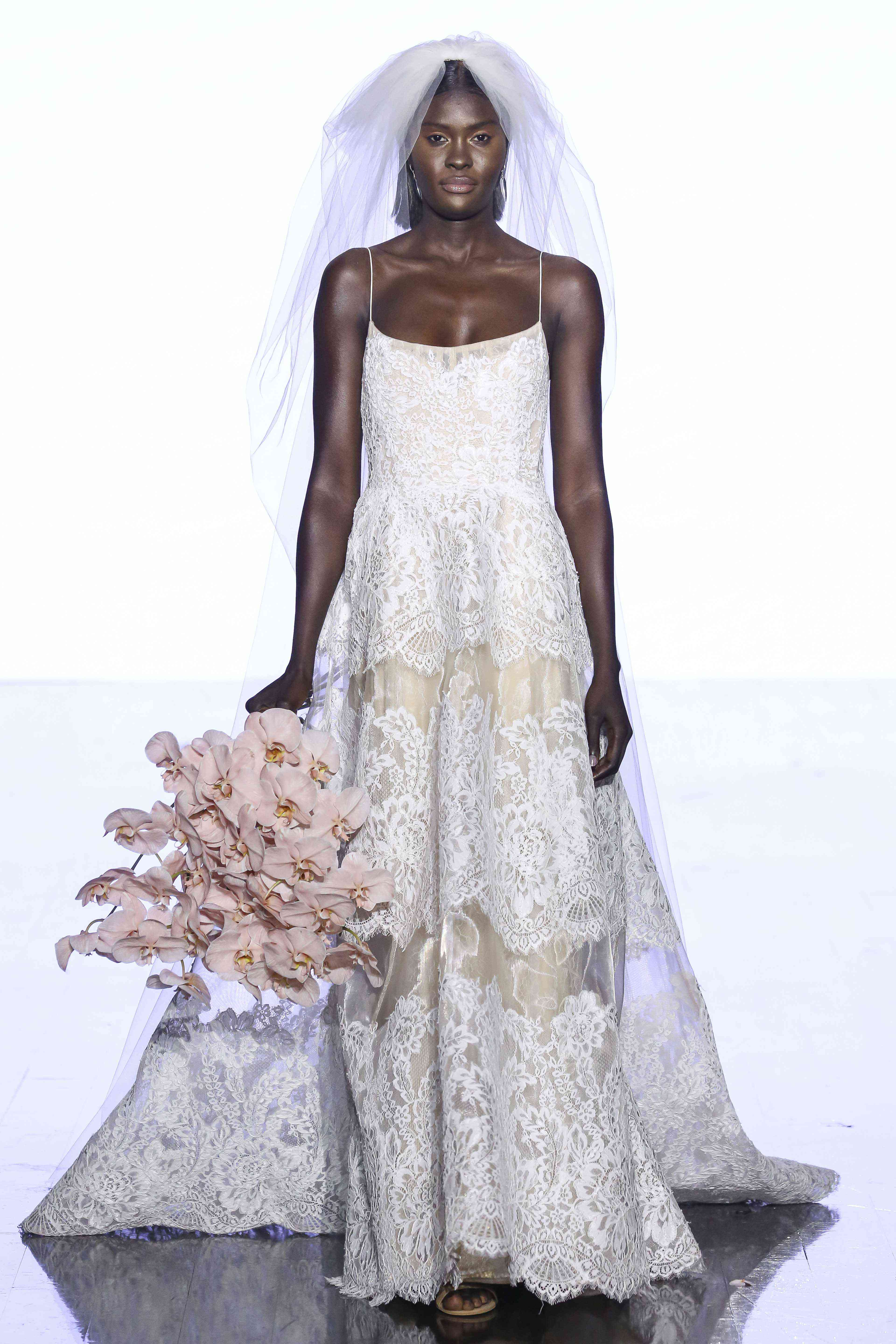 Model in scoop-neck layered lace ballgown