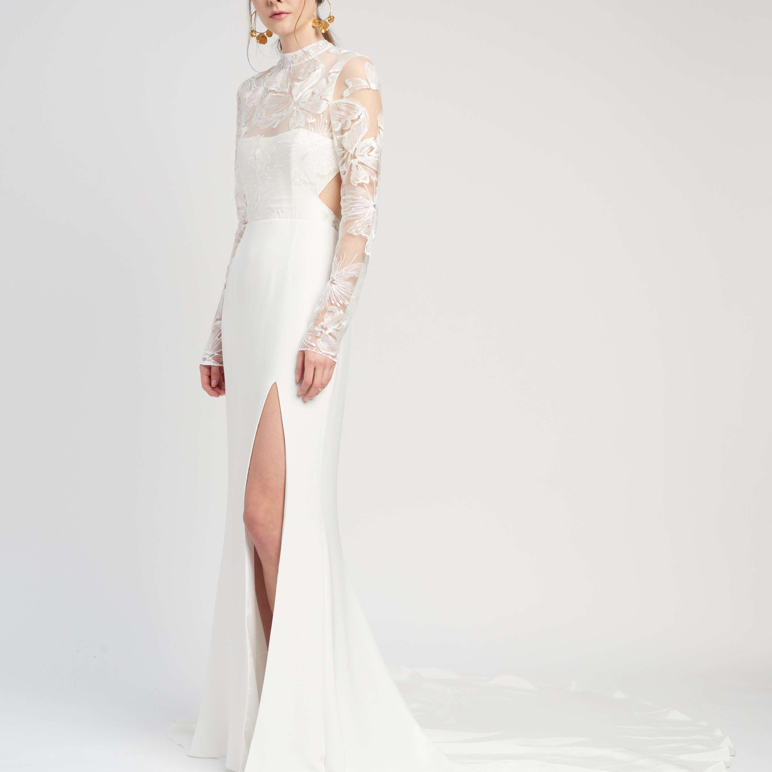Model in illusion neckline and sleeve wedding gown