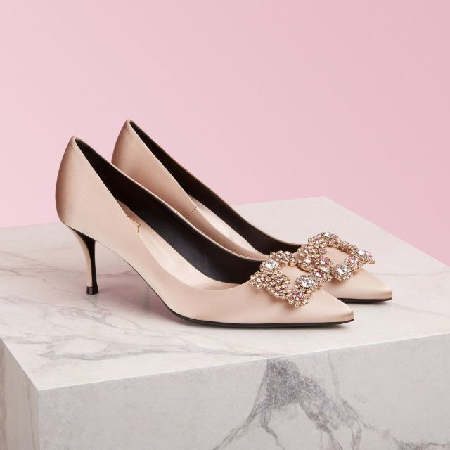 Light rose gold satin short pumps with crystal flower embellishment at the toe