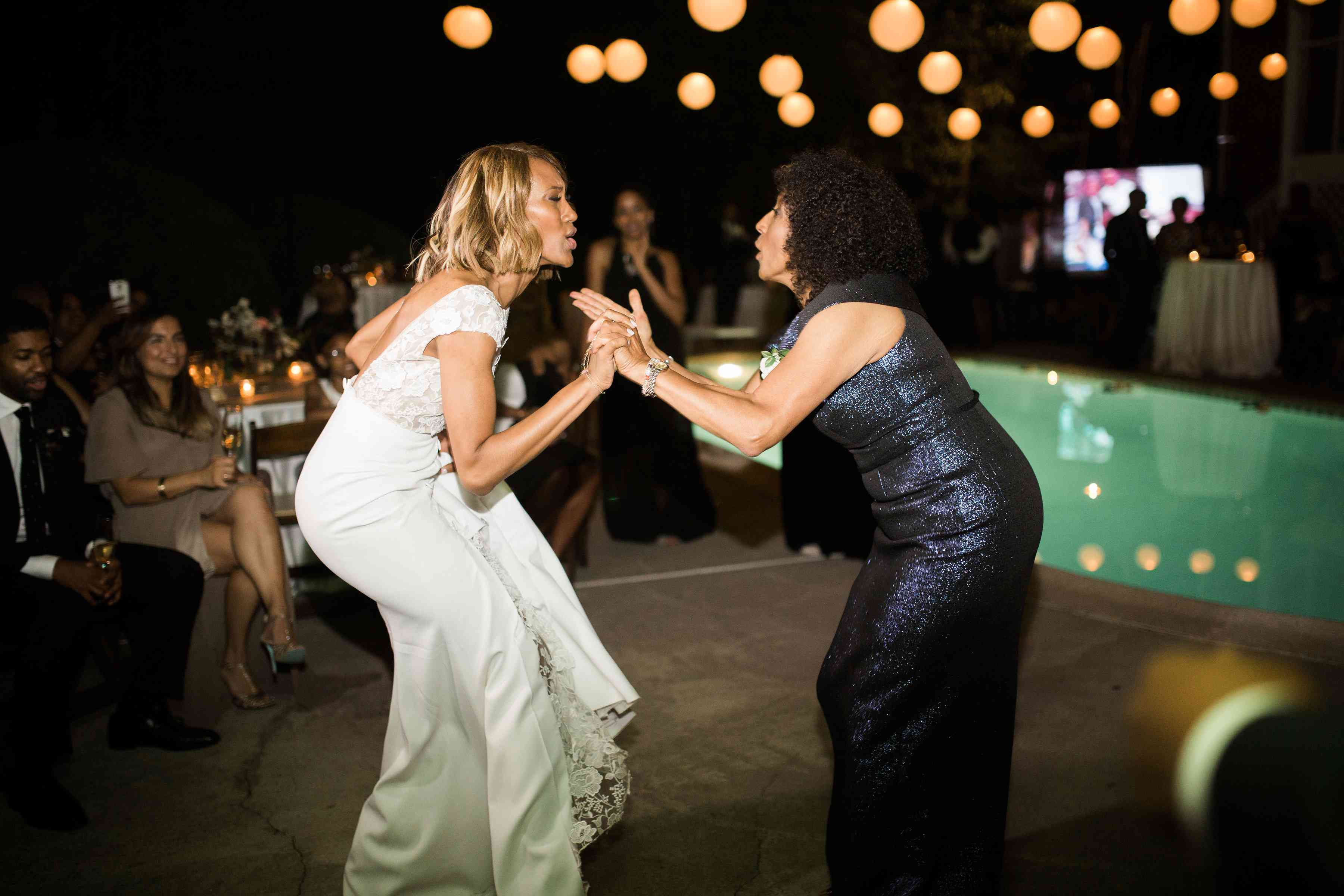 Bride and mother dance during reception