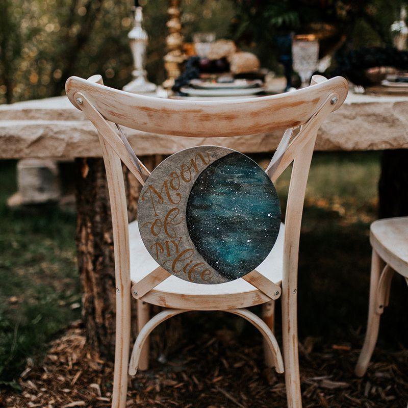 Wooden chair with moon decor