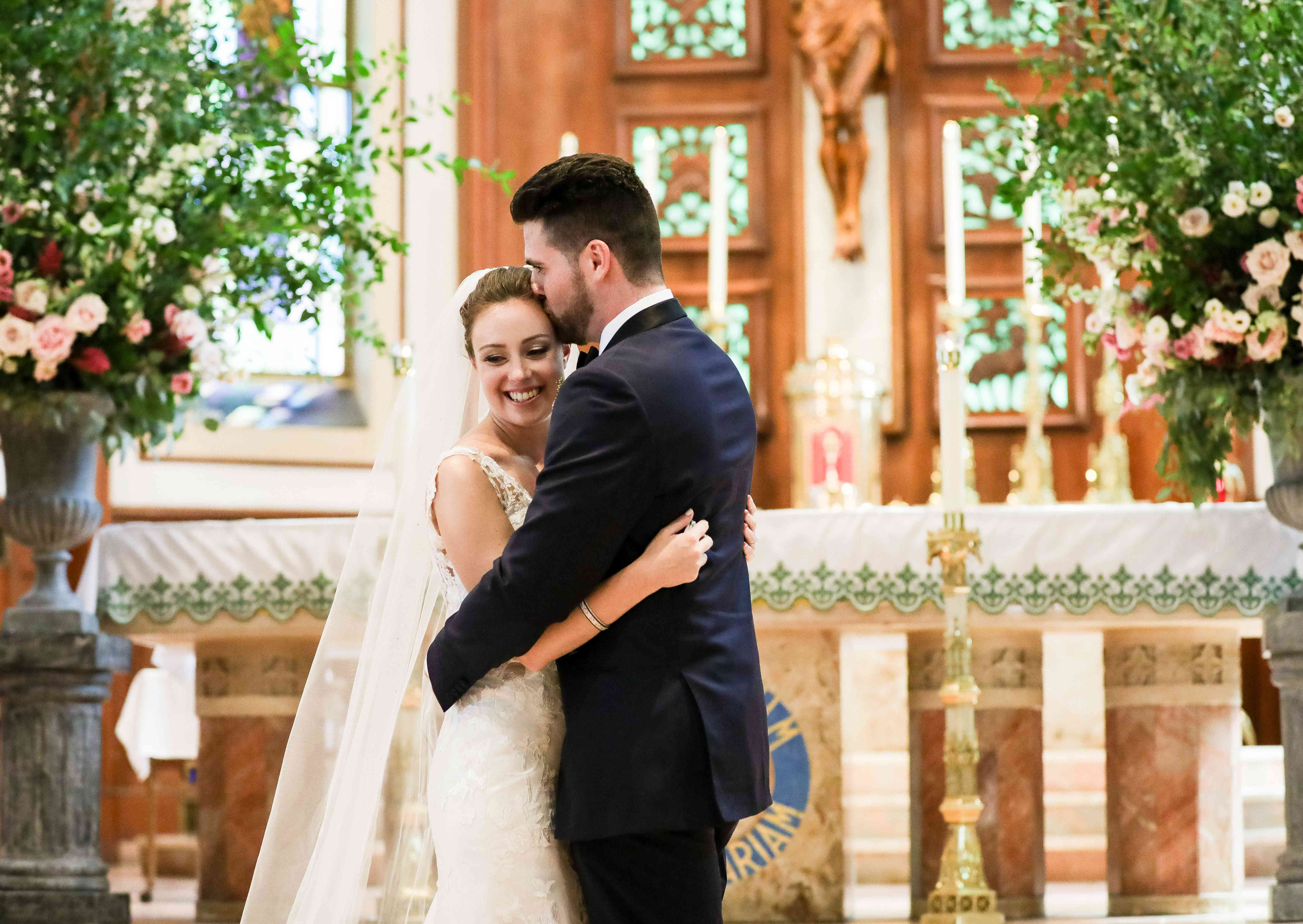 <p>bride and groom at altar church ceremony</p><br><br>