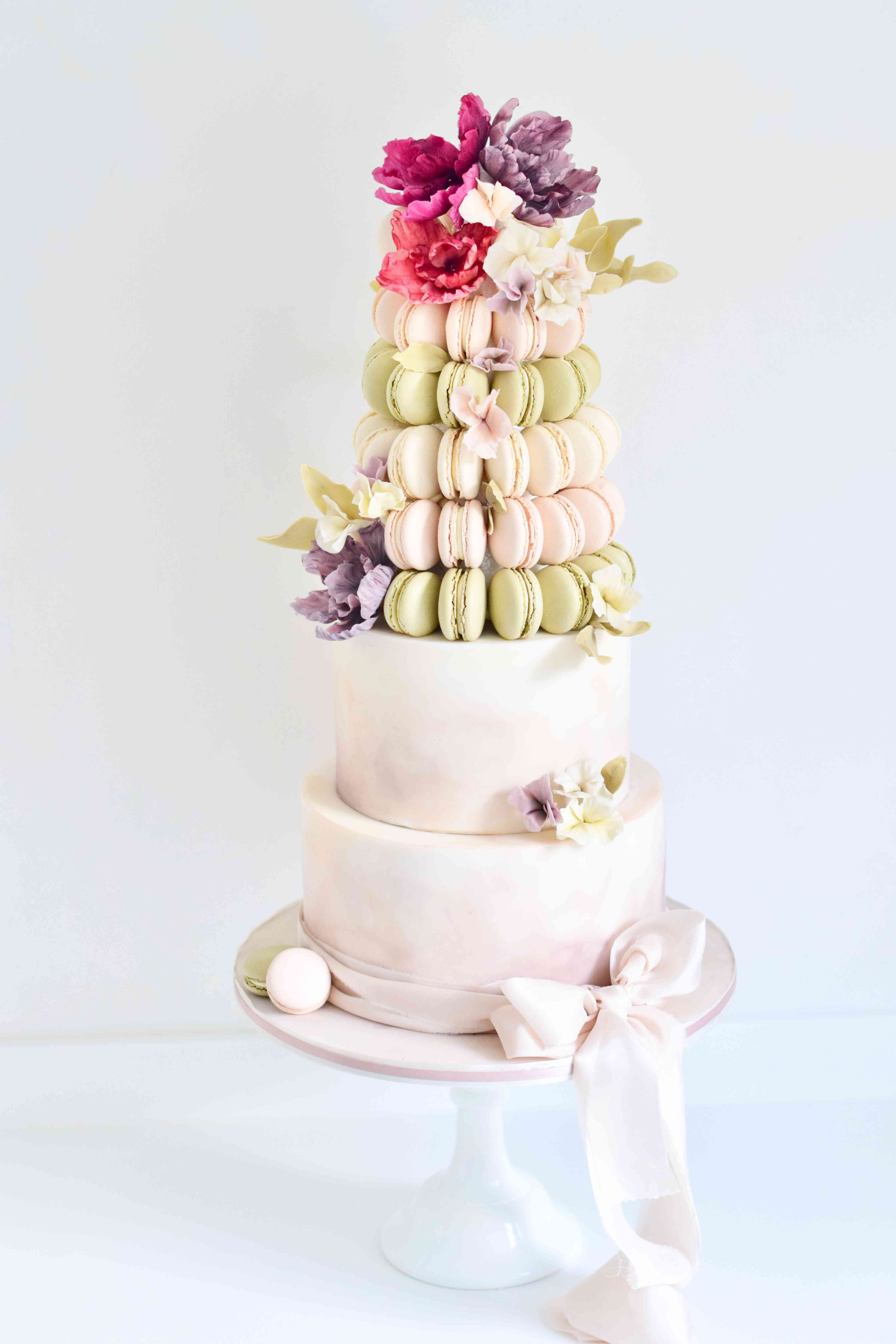 Pastel pink and green macaron wedding cake