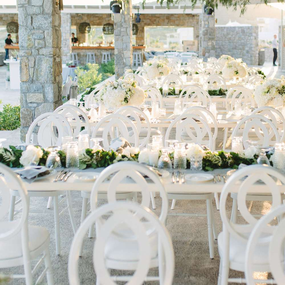 long white tables outdoor reception dinner