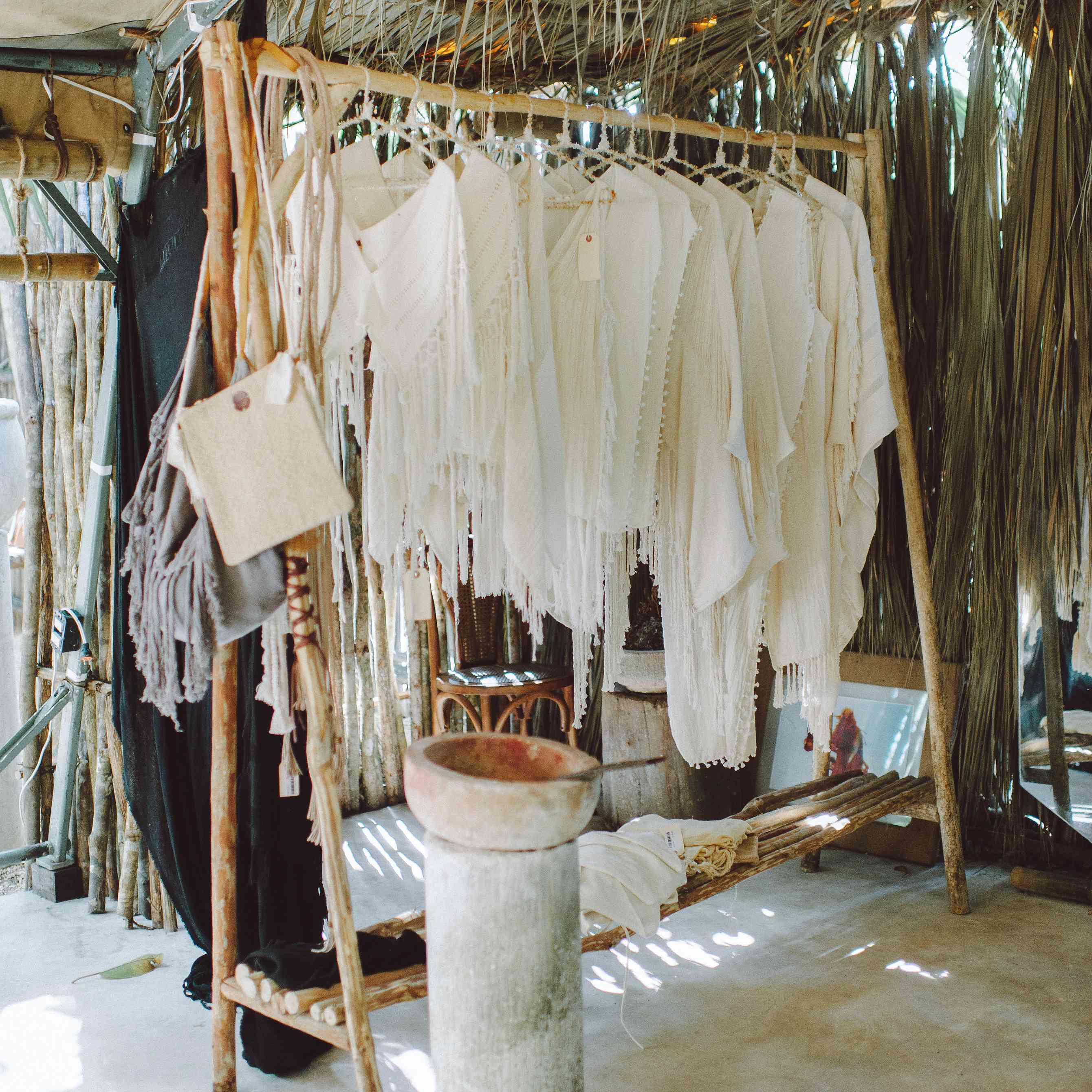 White clothes hanging on wooden rack