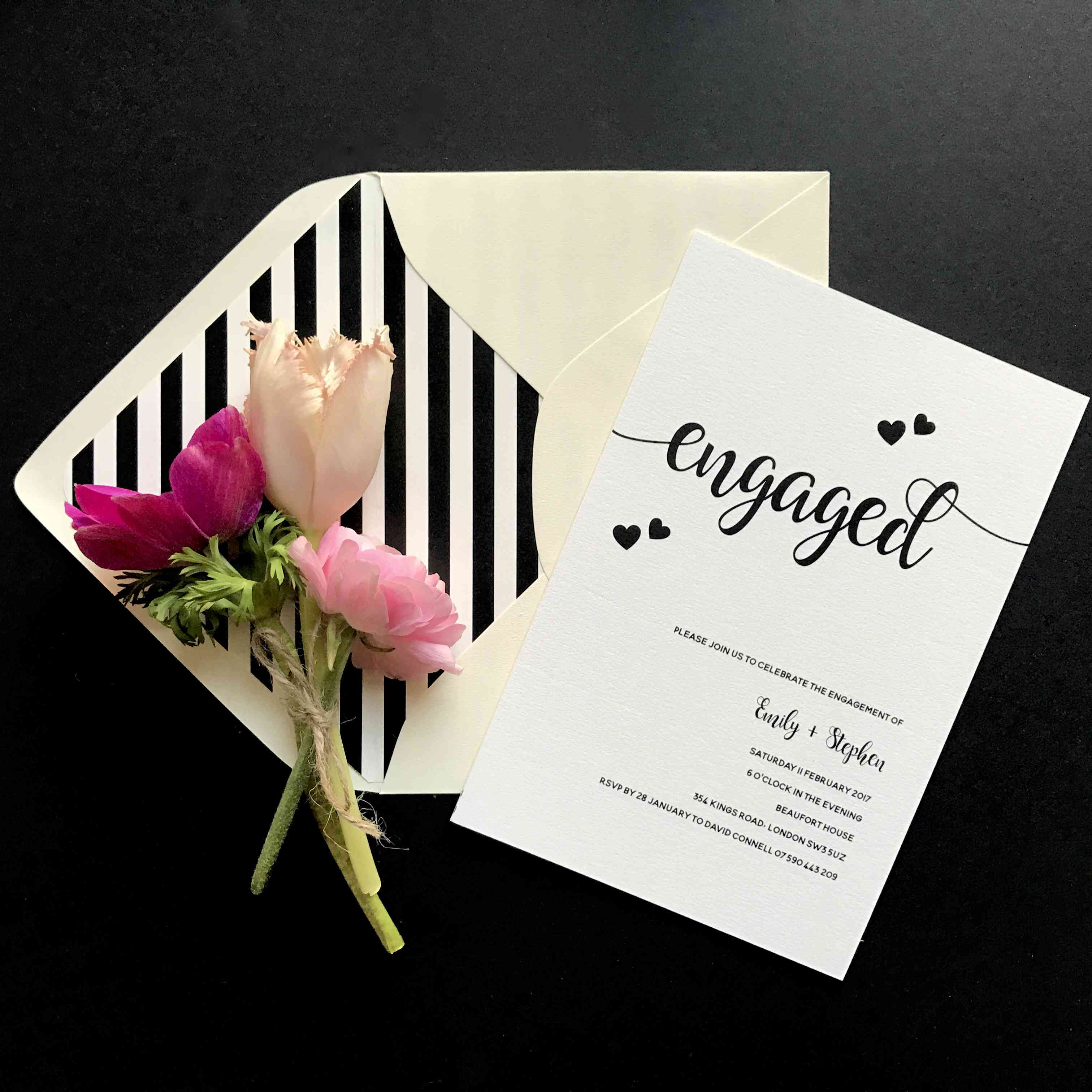 Cursive and hearts engagement party invitation