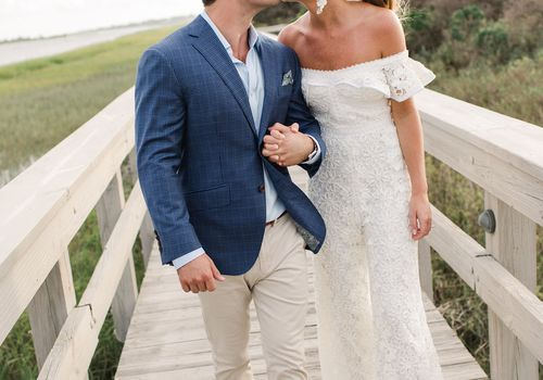 timeless southern wedding, bride and groom kissing rehearsal dinner