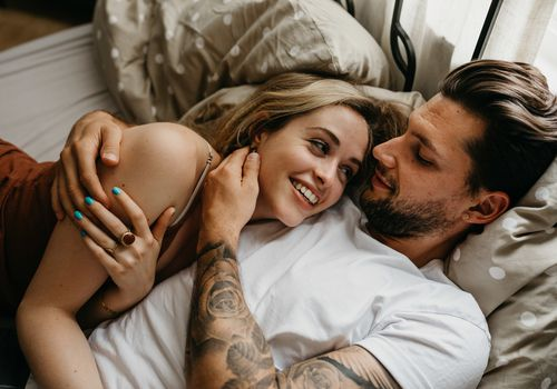 happy couple laying in bed