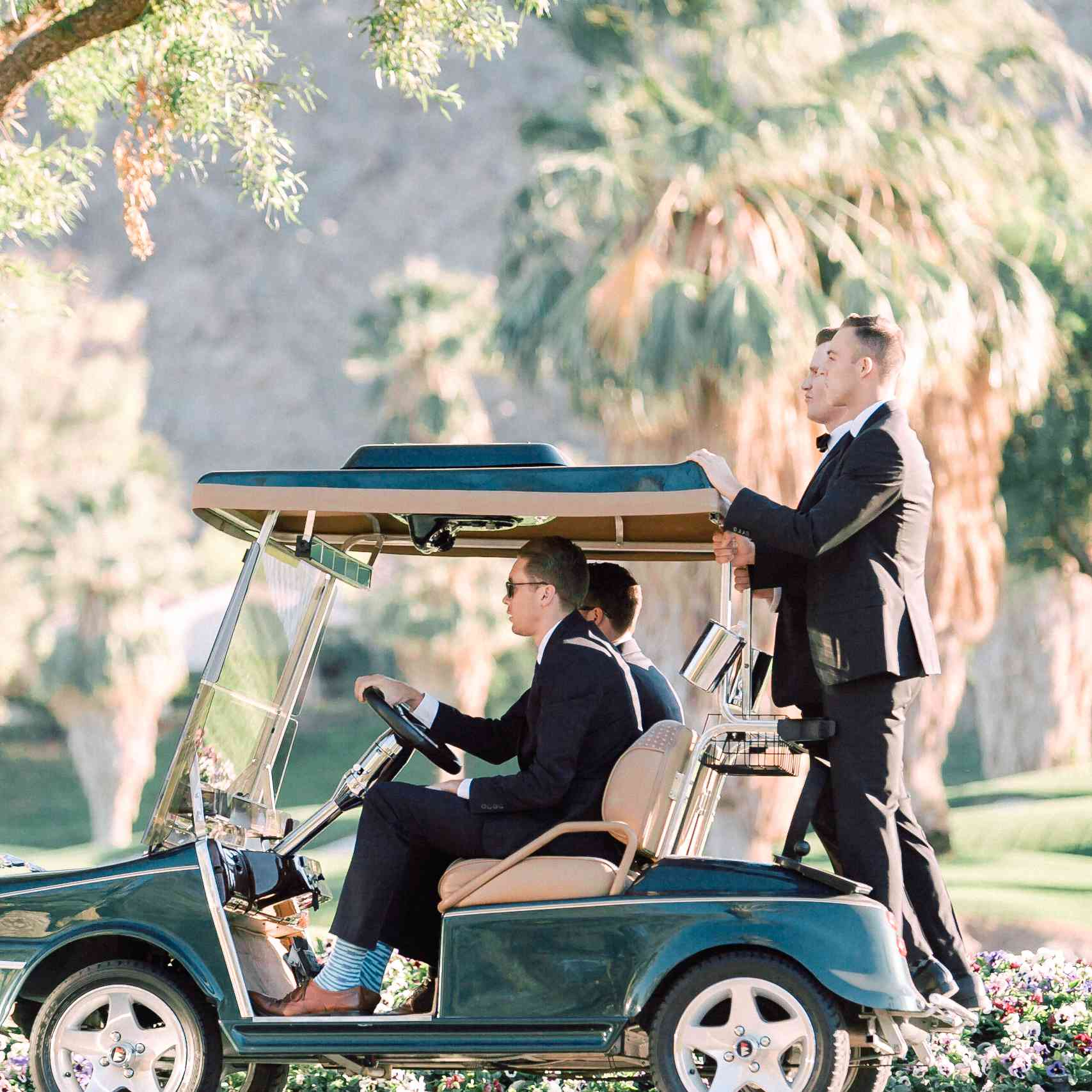 <p>groomsman on golf cart</p><br><br>