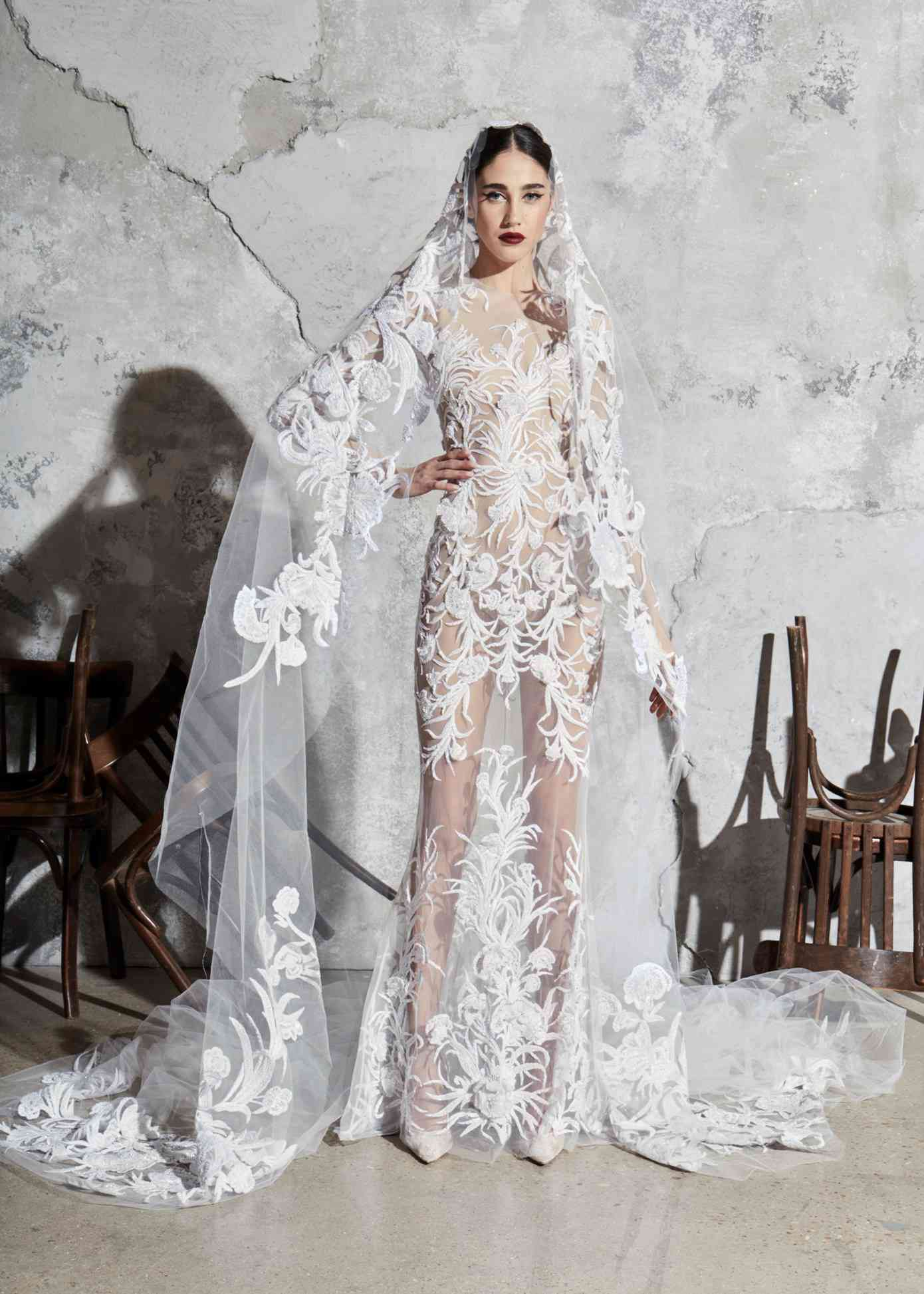 Model in allover illusion tulle dress with beaded embroidery and a matching veil