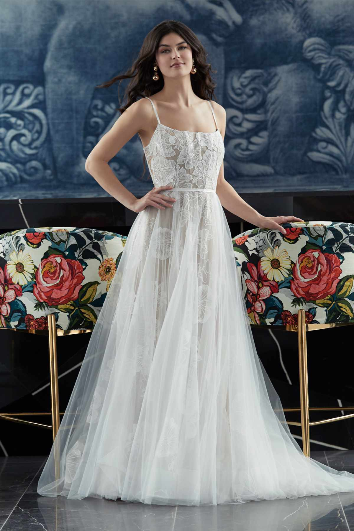 Model in allover floral lace gown with tulle A-line overskirt