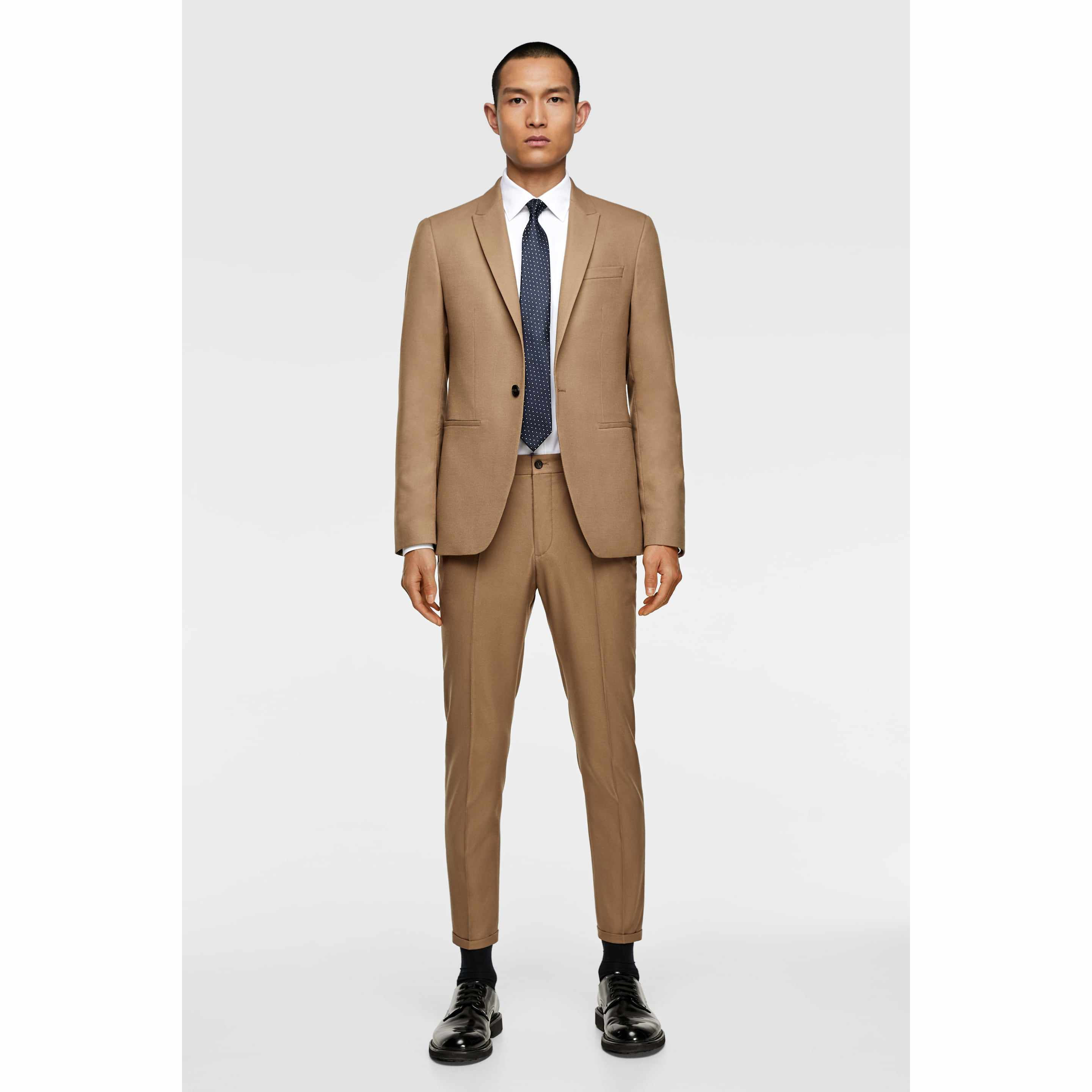 8f77ccf8 15 Stylish Men's Suits to Wear to a Spring or Summer Wedding