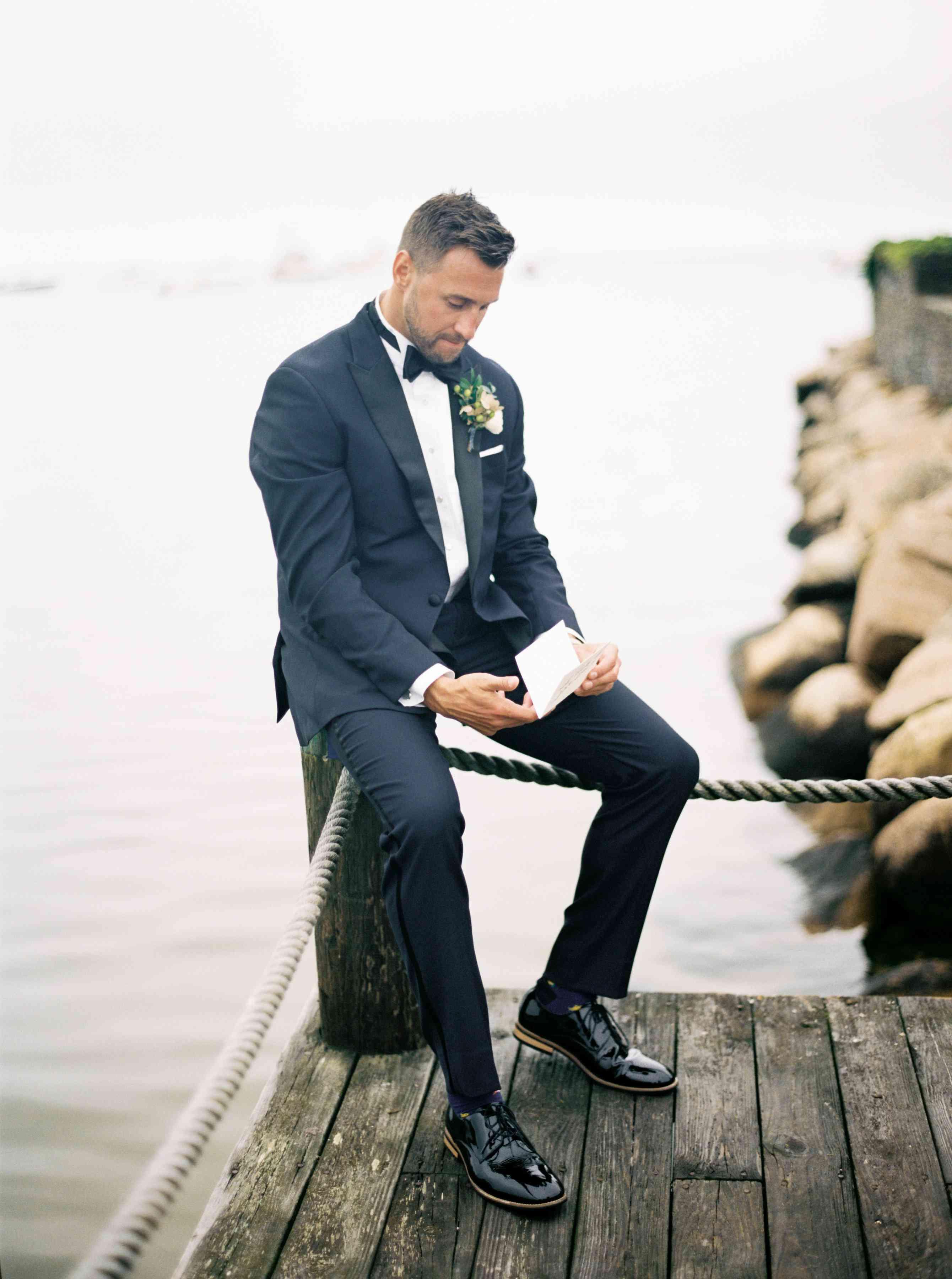 groom in blue tuxedo