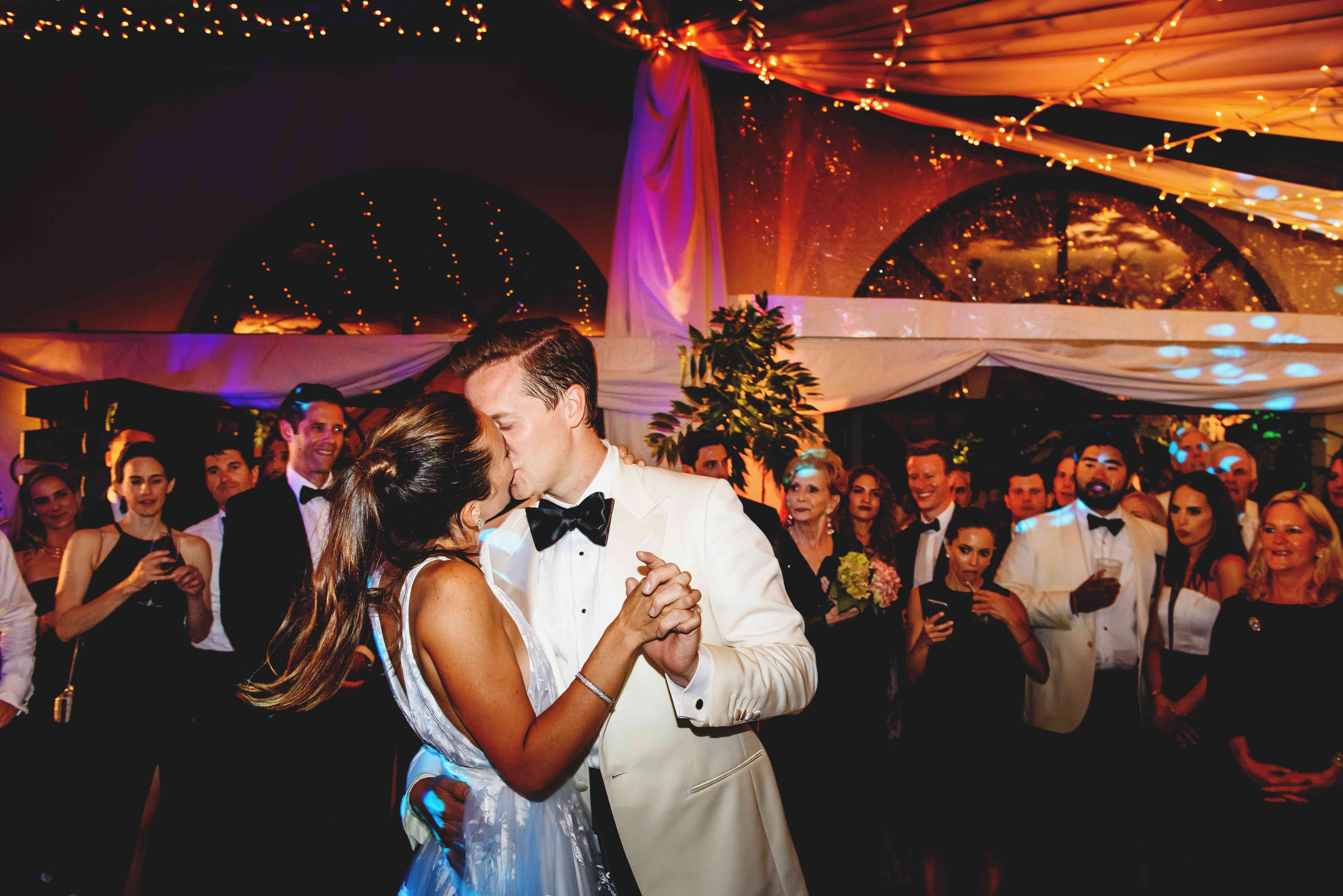 bride and groom kissing wedding reception