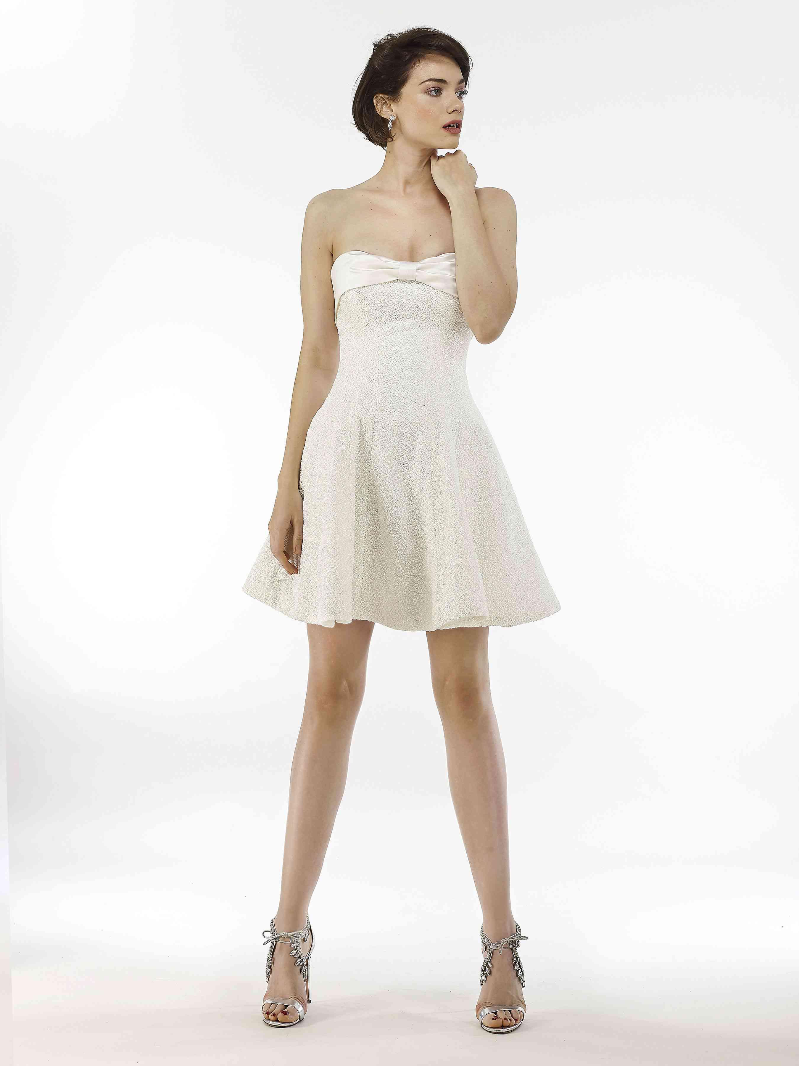 Model in strapless mini dress with flared skirt