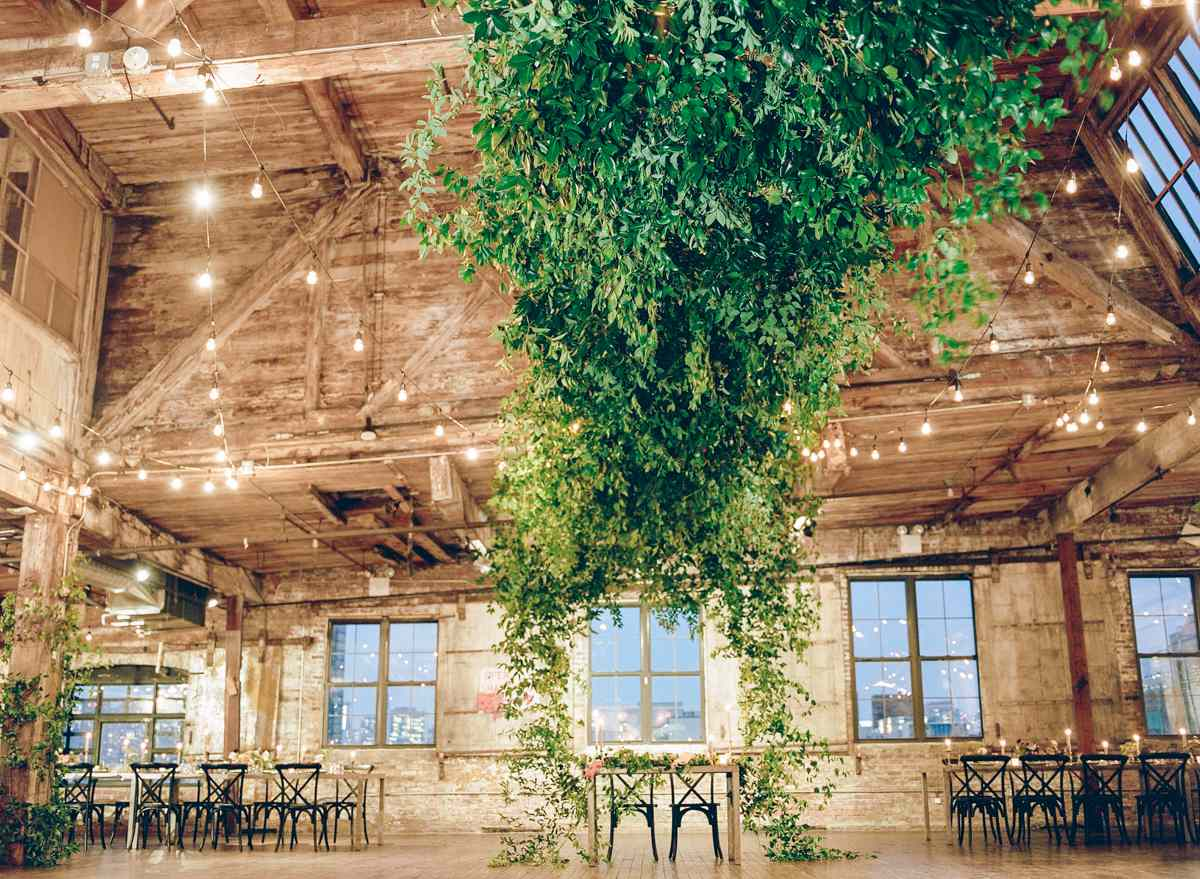 Sweetheart table under hanging installation of greenery