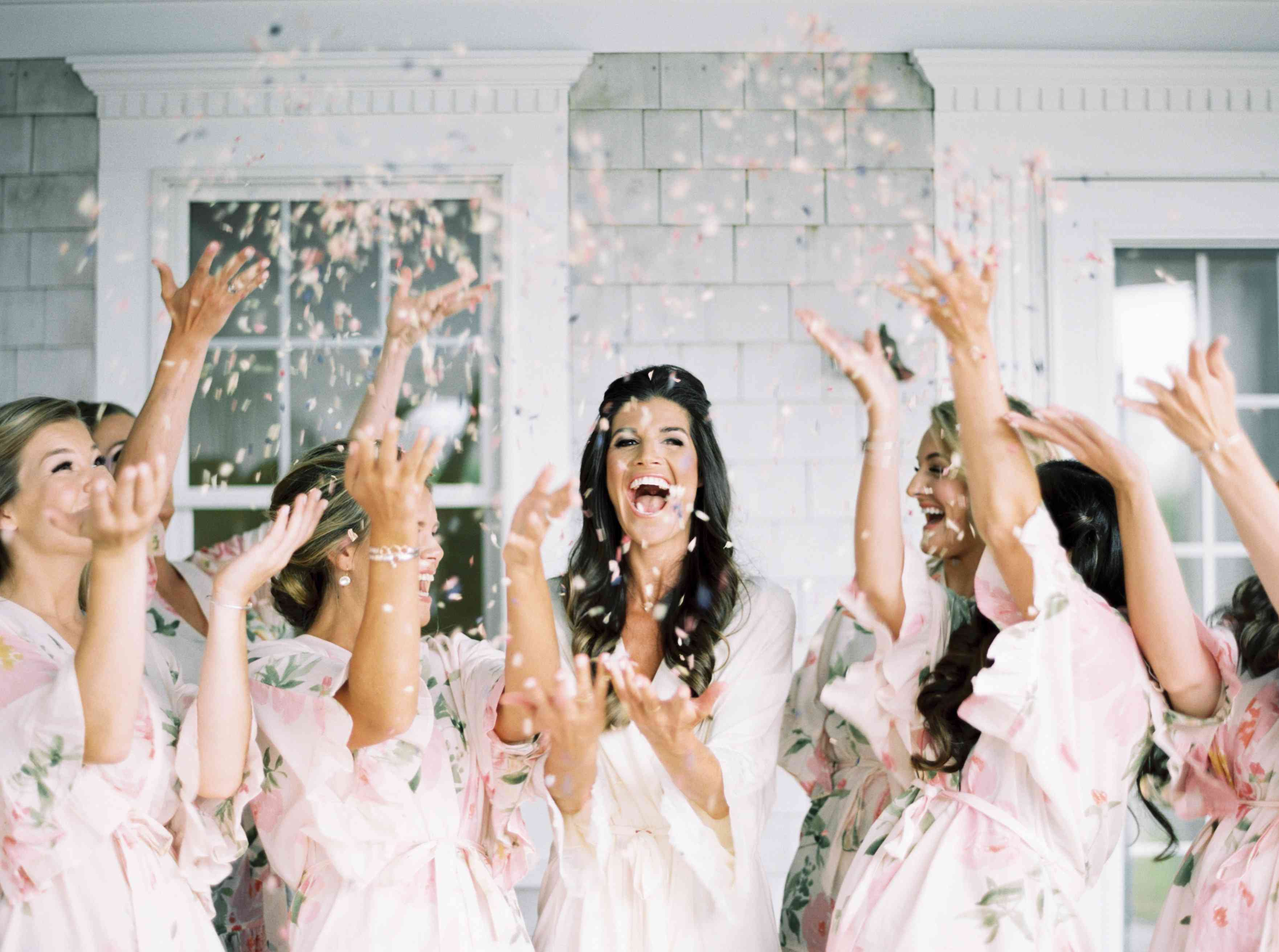 getting ready with bridesmaids celebrating