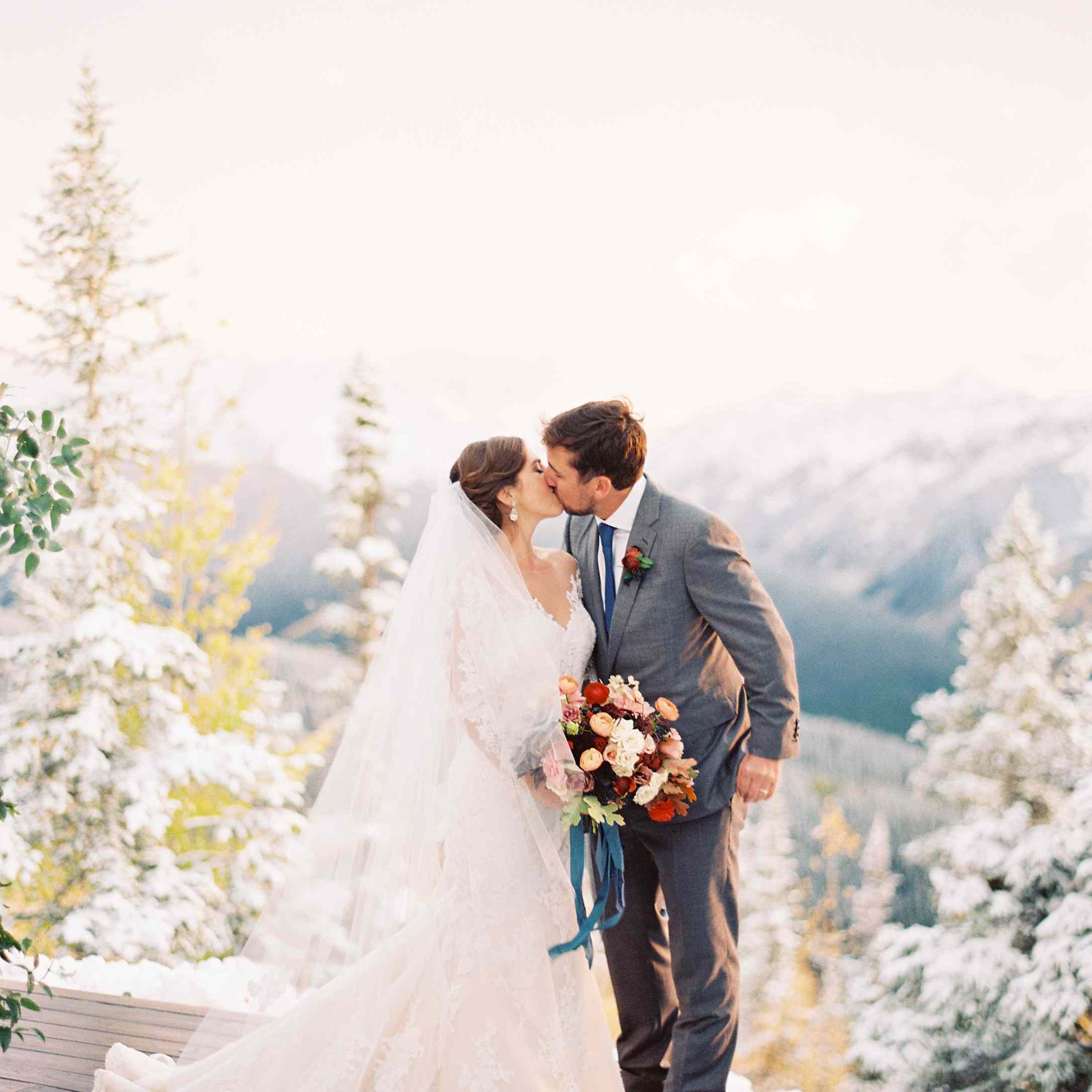 Bride and groom kissing in Aspen