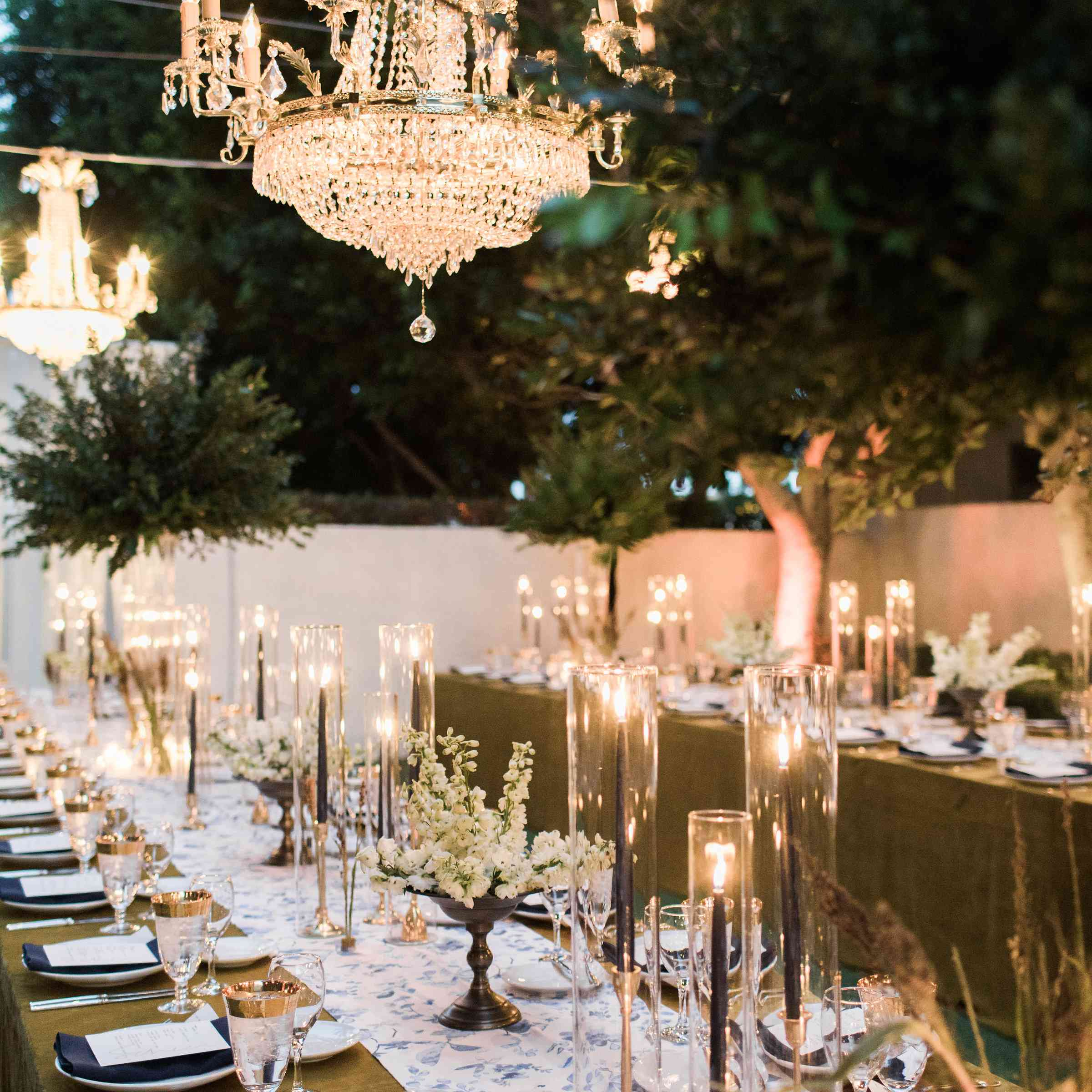 <p>outdoor reception under chandeliers gold and navy decor</p><br><br>