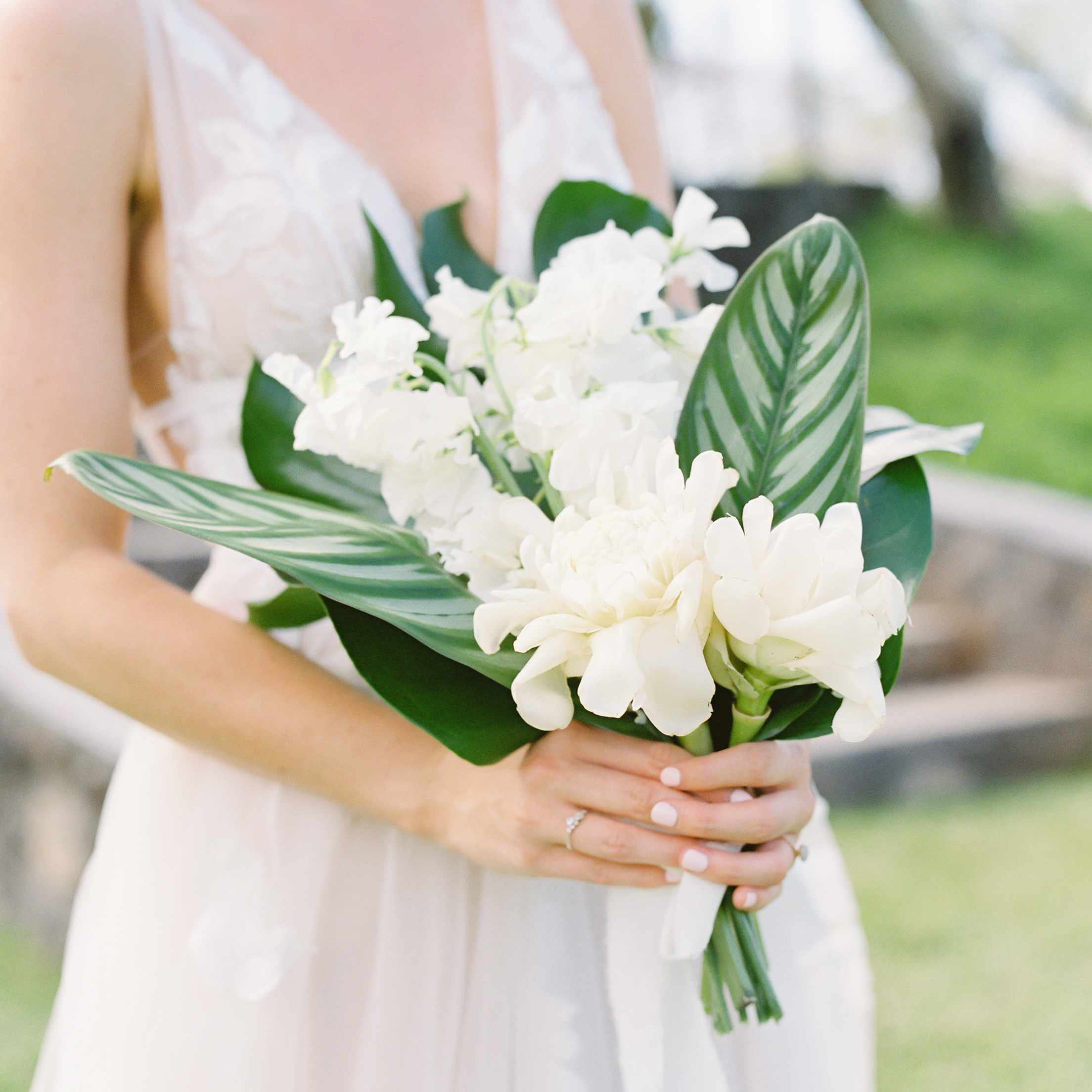 tropical maui wedding, bride holding tropical bouquet