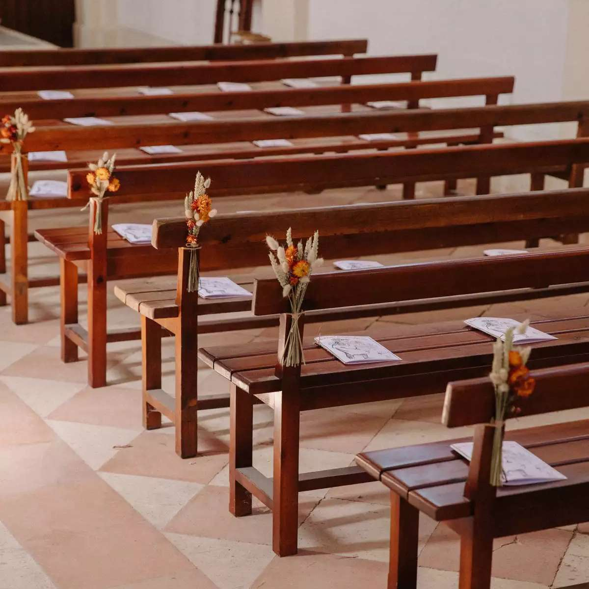 church pews with dried flowers