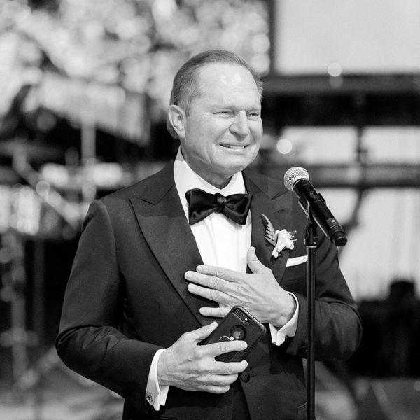 Father giving a heartfelt speech at a wedding