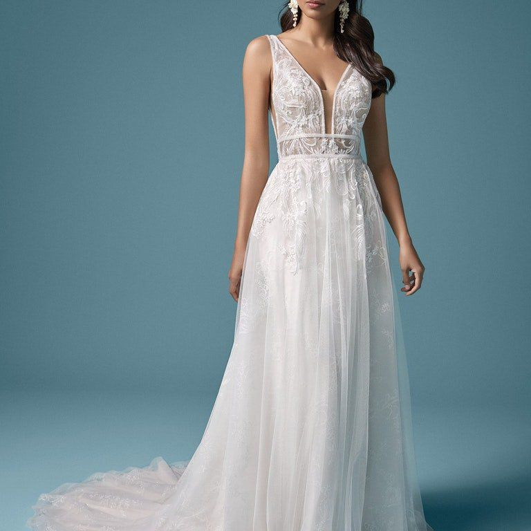 Model in illusion bodice wedding gown with floral lace