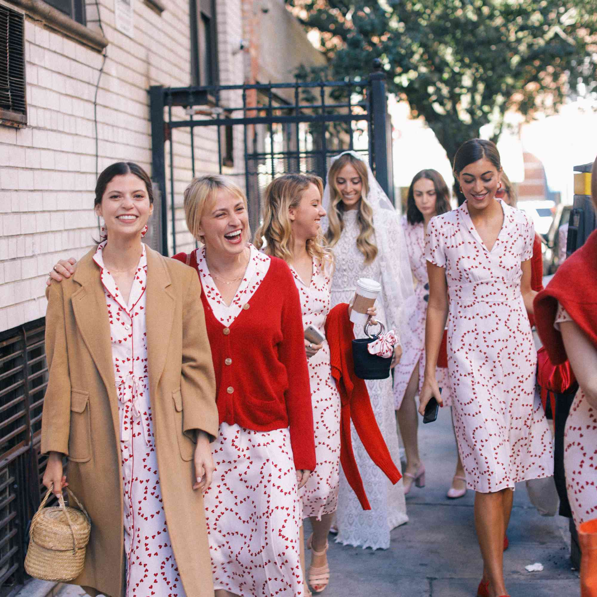 Bridesmaids wearing white dresses with red hearts