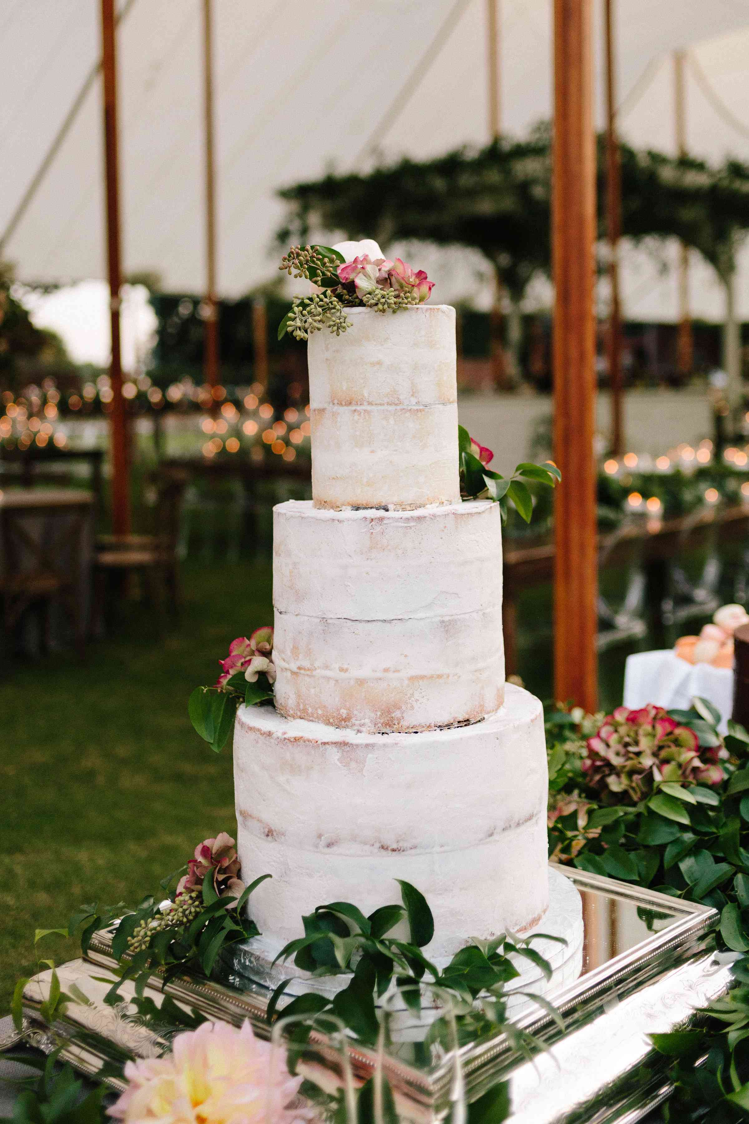 <p>semi-naked wedding cake with strawberry filling</p>