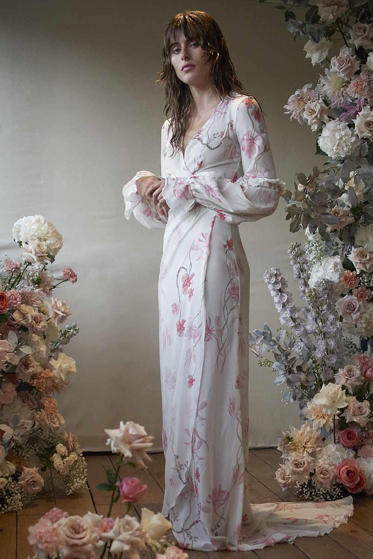 Model in pink floral wedding wrap dress