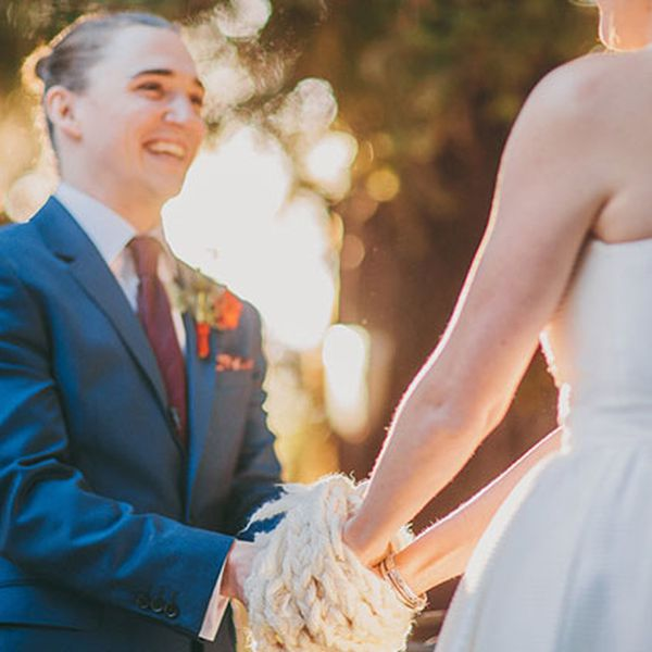 A couple in a handfasting ceremony.