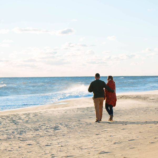 Couple walking together on Virginia Beach