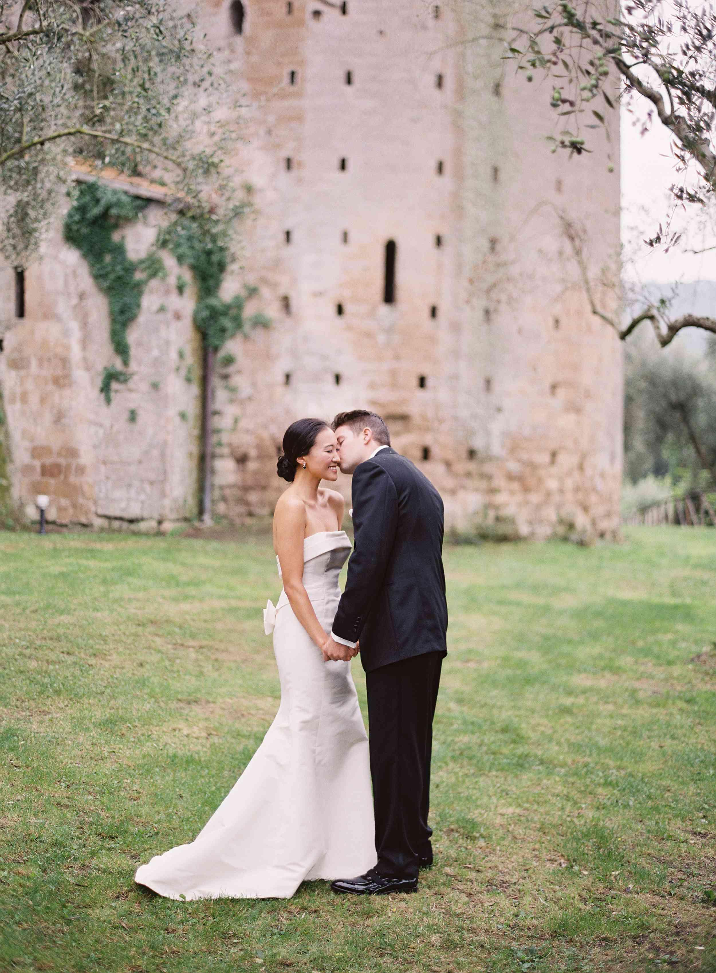 classic la badia italian wedding, groom kissing bride