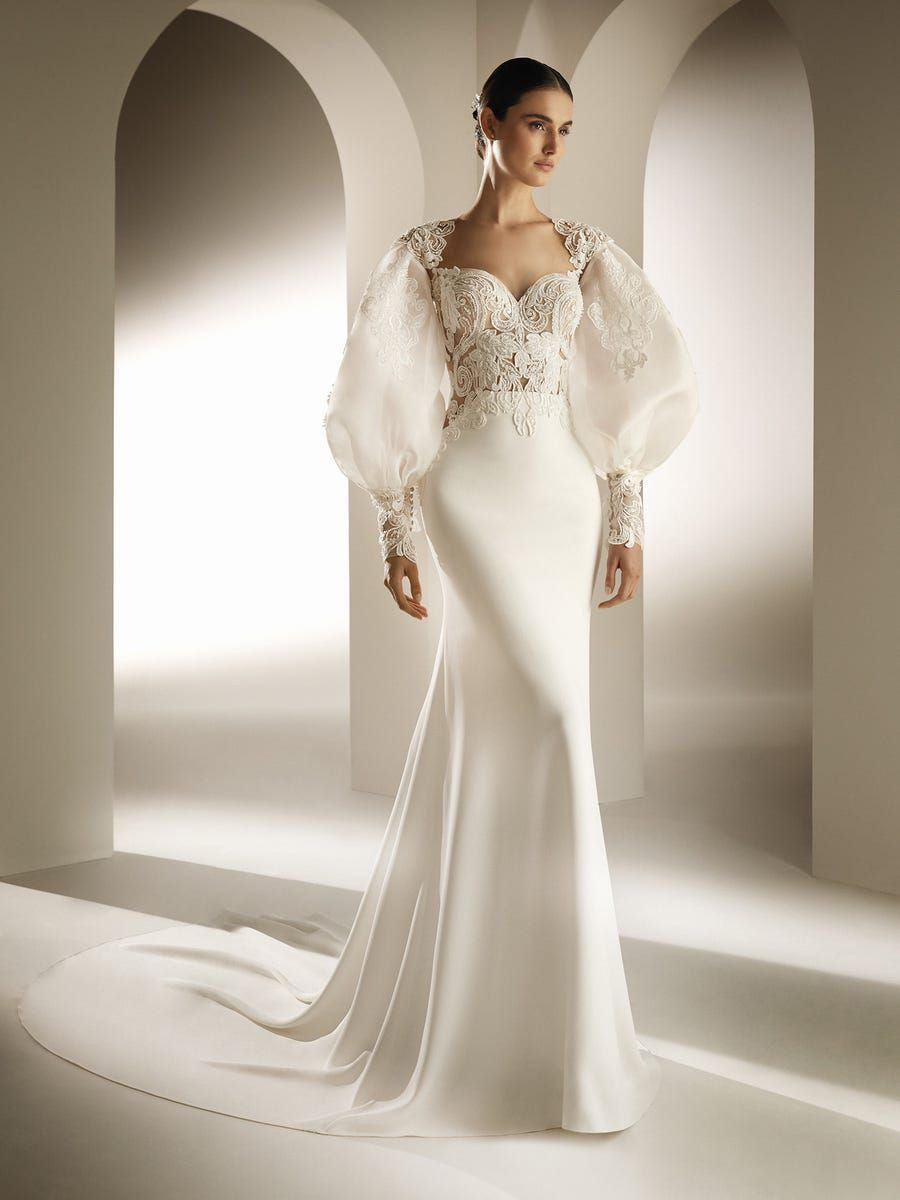 Model in mermaid wedding dress with puff sleeves and embroidered bodice