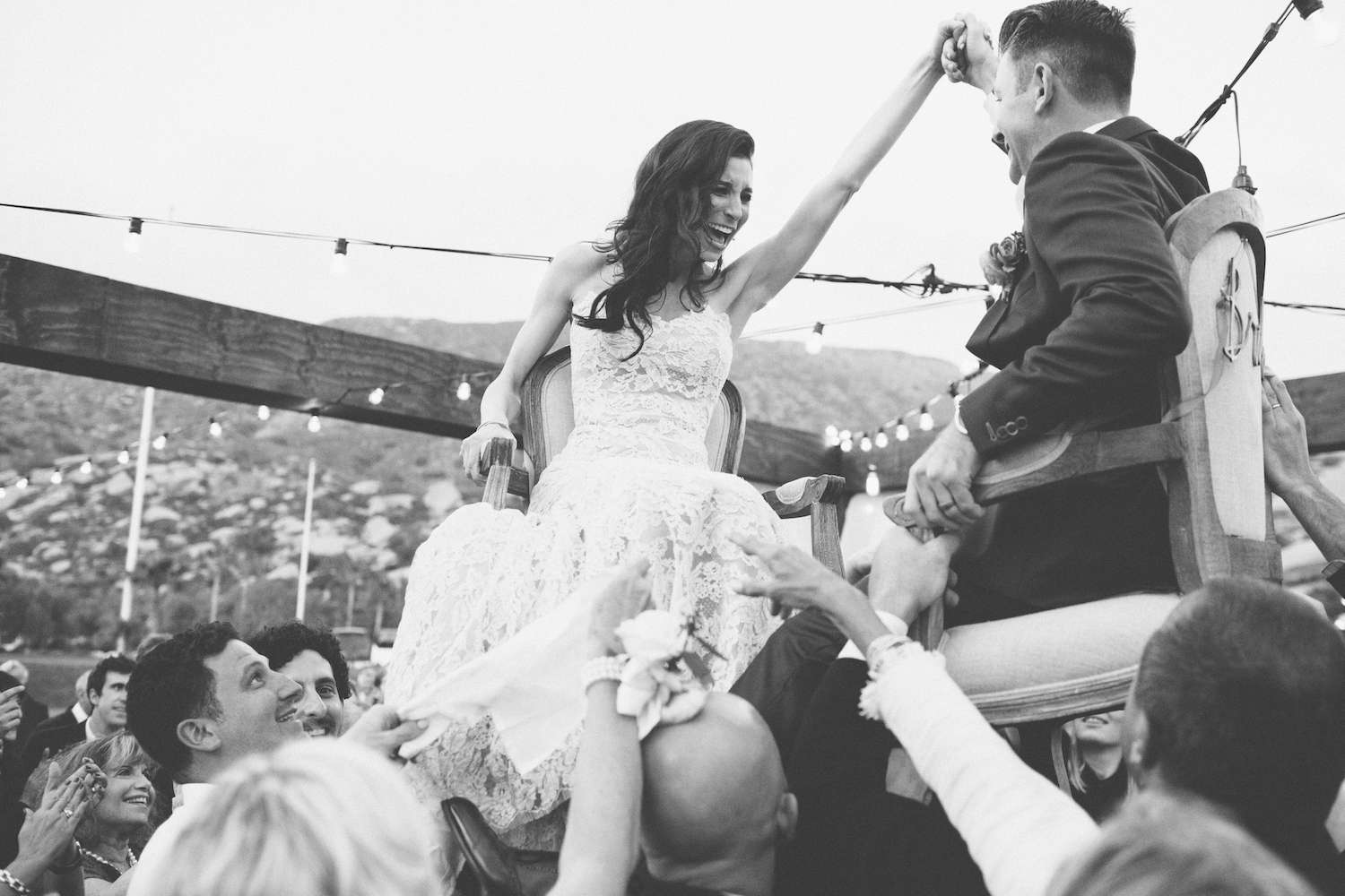 Bride and groom in chairs