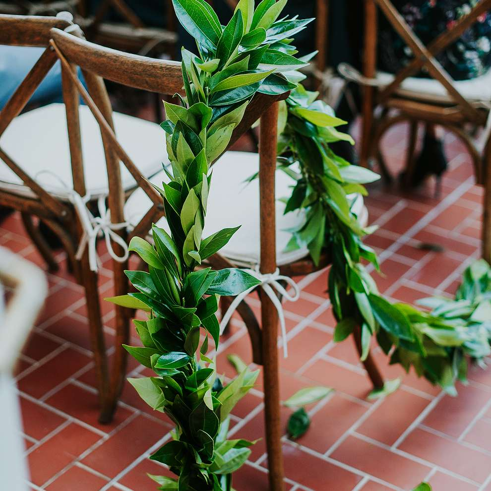 Greenery on Ceremony Chairs