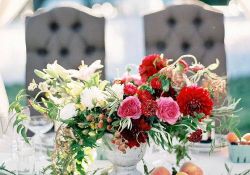 <p>Pink and Red Wedding Flowers at Sweetheart Table</p>