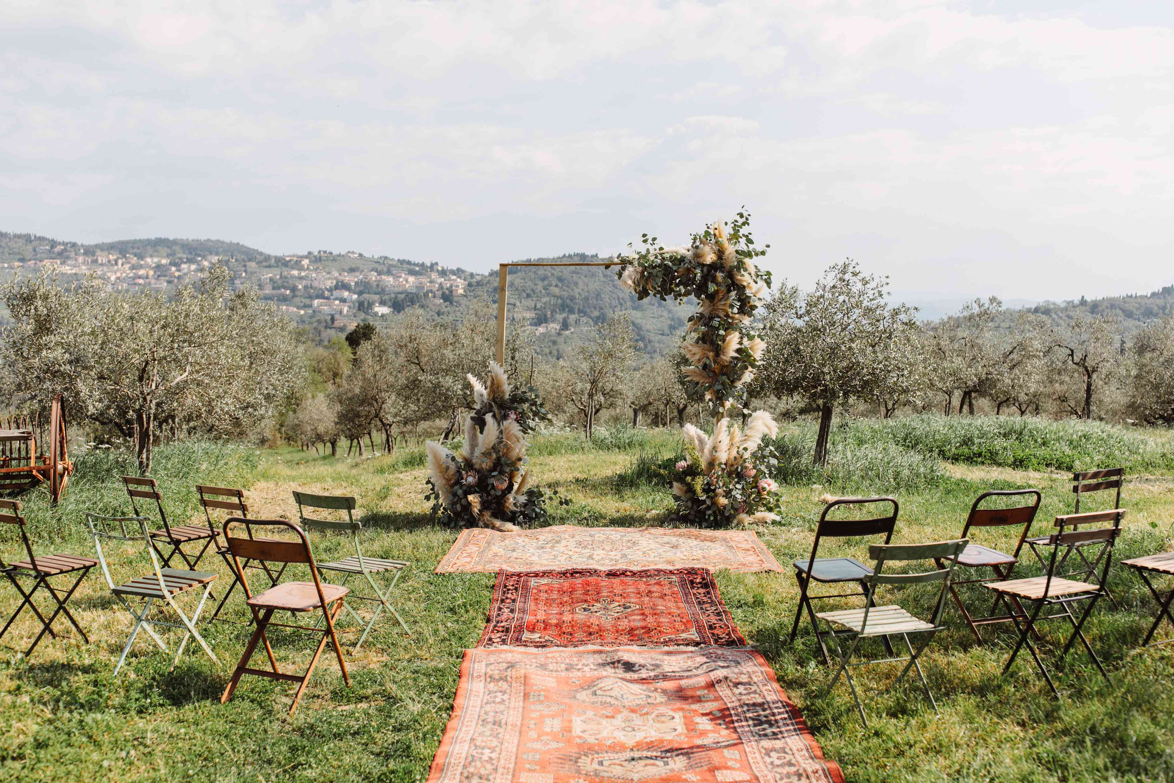 small ceremony rugs in aisle and altar structure