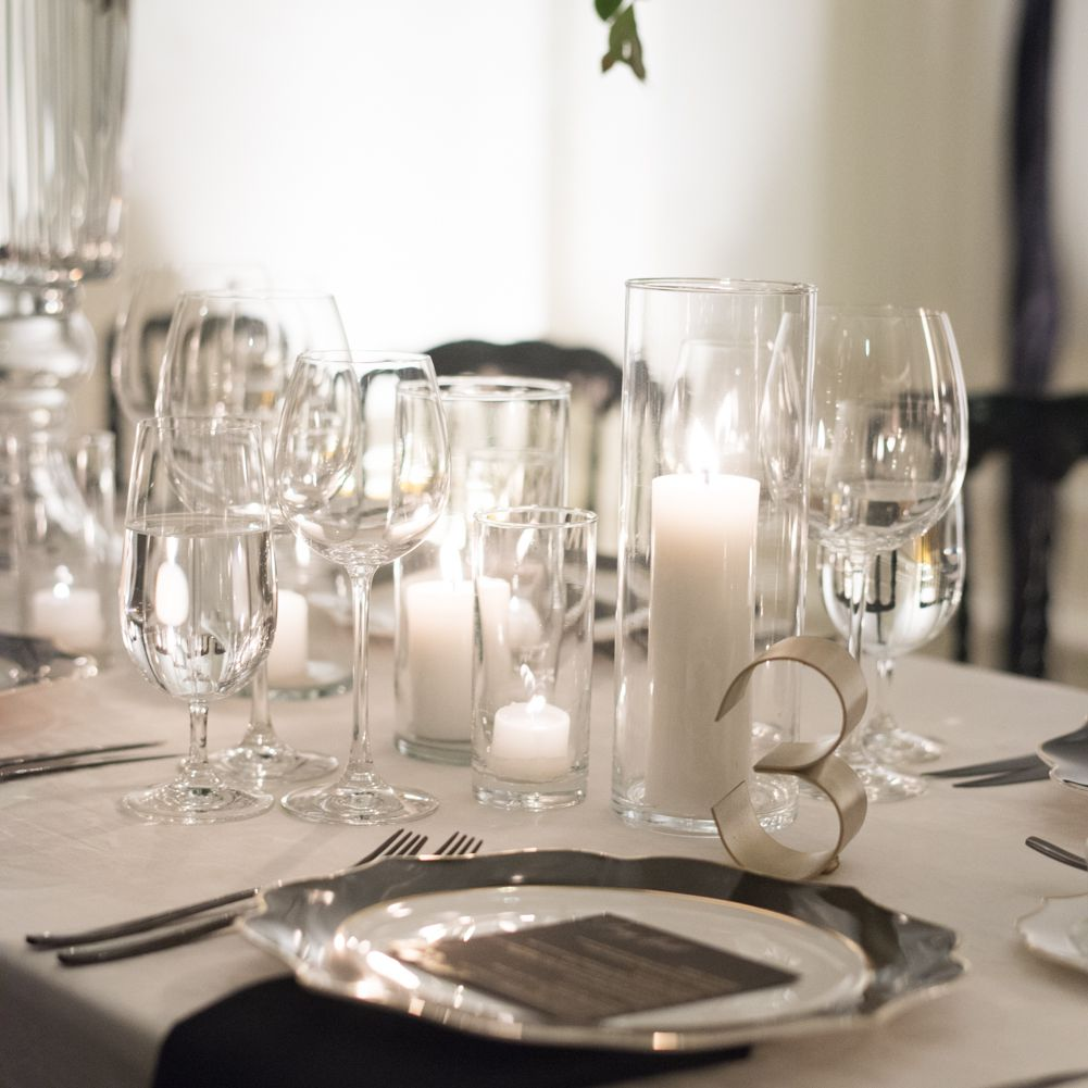 modern table numbers and cut crystal and candles