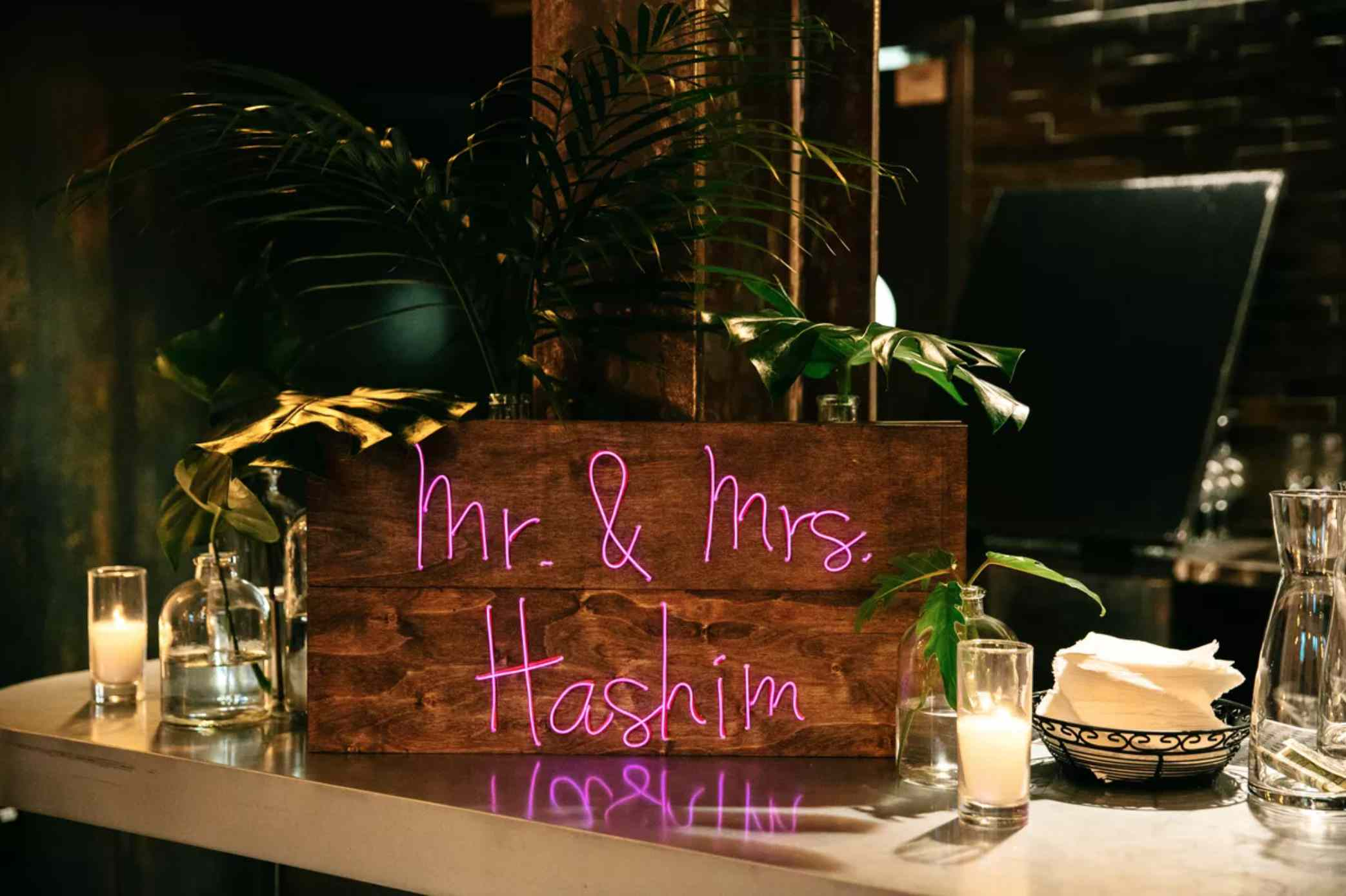Wooden neon bar sign with couples names